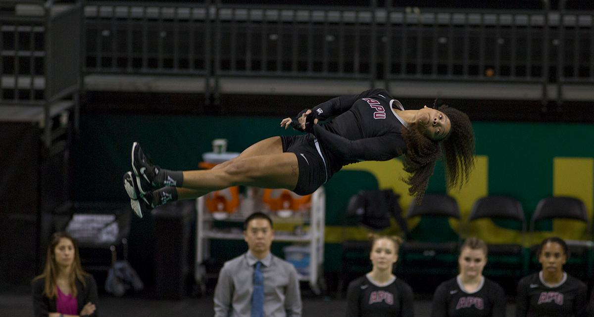 At their last home meet of the year and on Senior Night, the Ducks Acro and Tumbling Team defeated the Azusa Pacific Cougars, winning in all six categories: 38.70 to 37.20 in Compulsory; 29.35 to 28.60 in Acro; 29.40 to 29.35 in Pyramid; 29.35 to 28.95 in Toss; 57.525 to 66.15 in Tumbling; 103.75 to 98.03 in Team Routine; for an overall total of 288.08 to 277.28. The Ducks finished the season 6-1 and will next compete in the NCATA National Championship at Azusa, California April 27-29. Photo by Haley Bricker, Oregon News Lab