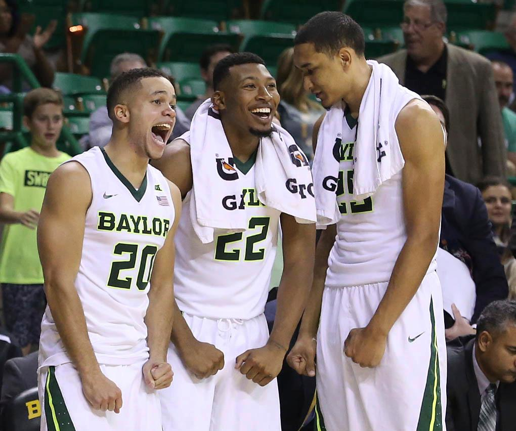 Baylor's Manu Lecomte (20), King McClure (22) and Tristan Clark (25) react during a game against Central Arkansas in the second half of their NCAA college basketball game, Friday, Nov. 10, 2017, in Waco, Tx. Baylor won 107-66. (AP Photo/Jerry Larson)