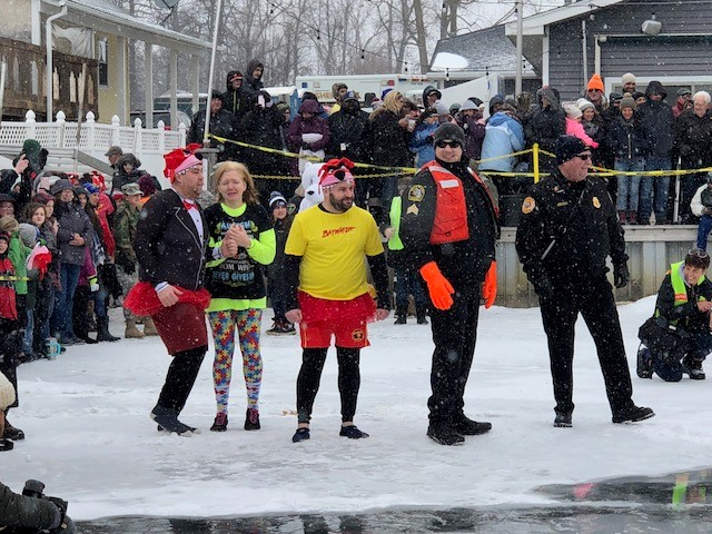 Hundreds took part in the Fenton Polar Plunge to help raise money for the Michigan Special Olympics. (Photo Credit: Jasmyn Durham)<p></p>