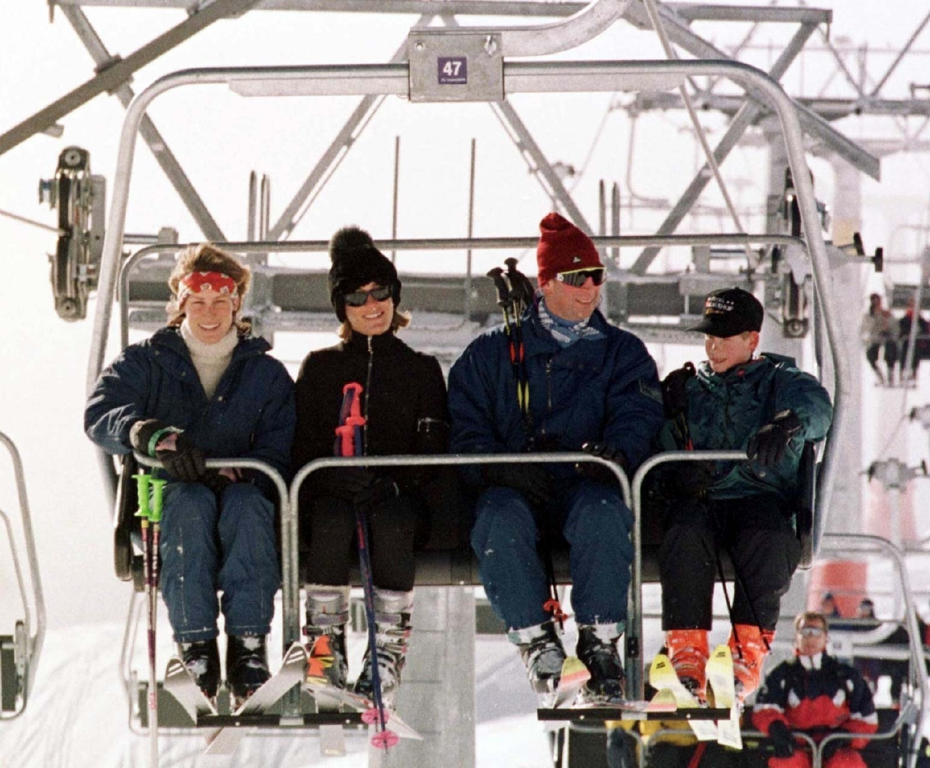 "FILE - A Jan. 1, 1997 file photo of Britain's Prince Charles, 2nd right, with his younger son Prince Harry, right, joined in a ski lift by Santa Sebag Montefiore, with her sister, and Prince Charles' goddaughter, Tara Palmer-Tomkinson, on the way up the Gotschnabahn ski runs above Klosters, Switzerland. Palmer-Tomkinson,has been found dead in her London home. She was 45.  Prince Charles said in a statement Wednesday, Feb.8, 2017, that he and his wife, the Duchess of Cornwall, are ""deeply saddened"" by news of her death. The cause of death was not immediately clear, though she revealed last year that she had been diagnosed with a brain tumor. (John Stillwell/PA via AP, File)"