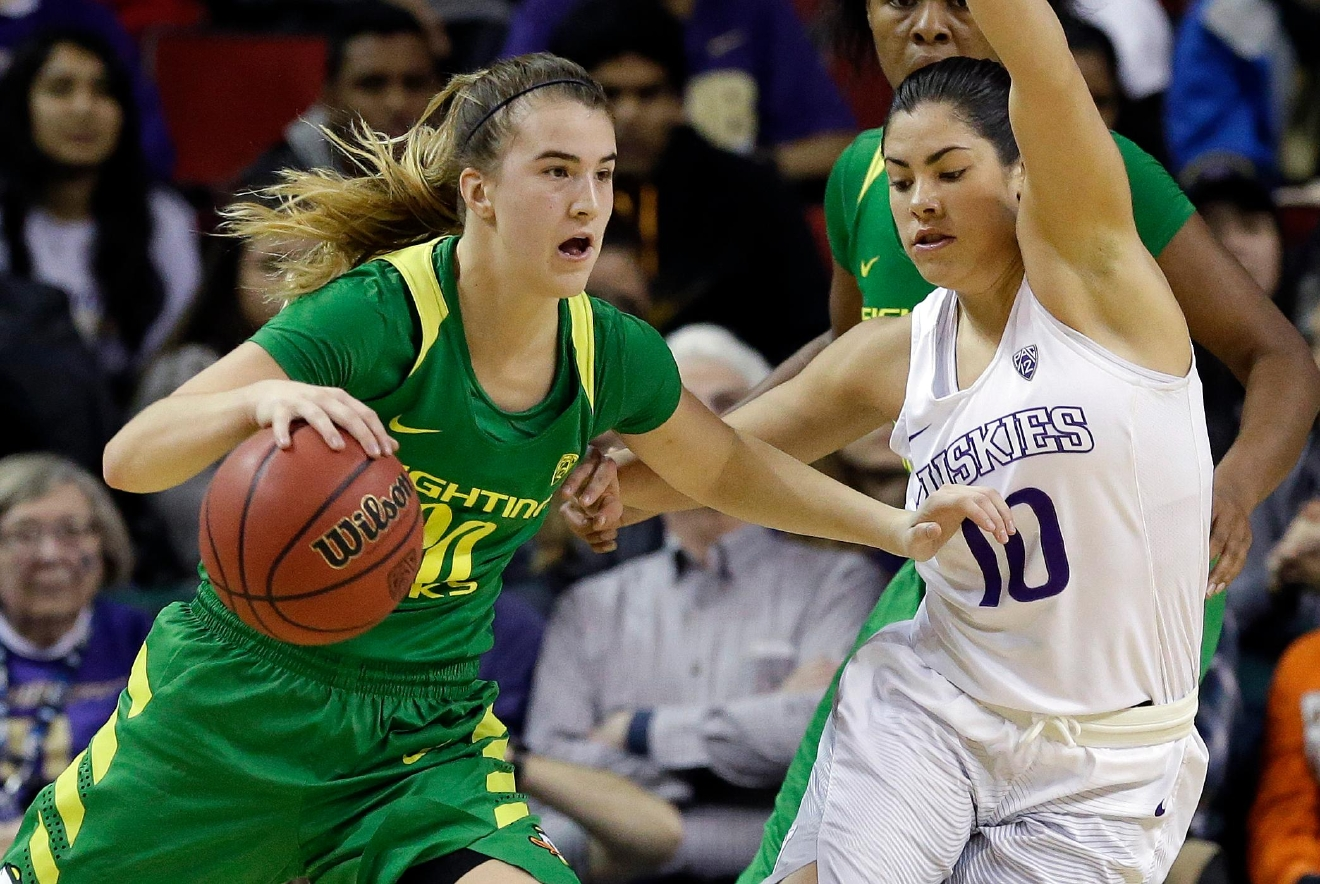 Oregon's Sabrina Ionescu, left, tries to get past Washington's Kelsey Plum during the first half of an NCAA college basketball game in the Pac-12 tournament, Friday, March 3, 2017, in Seattle. (AP Photo/Elaine Thompson)