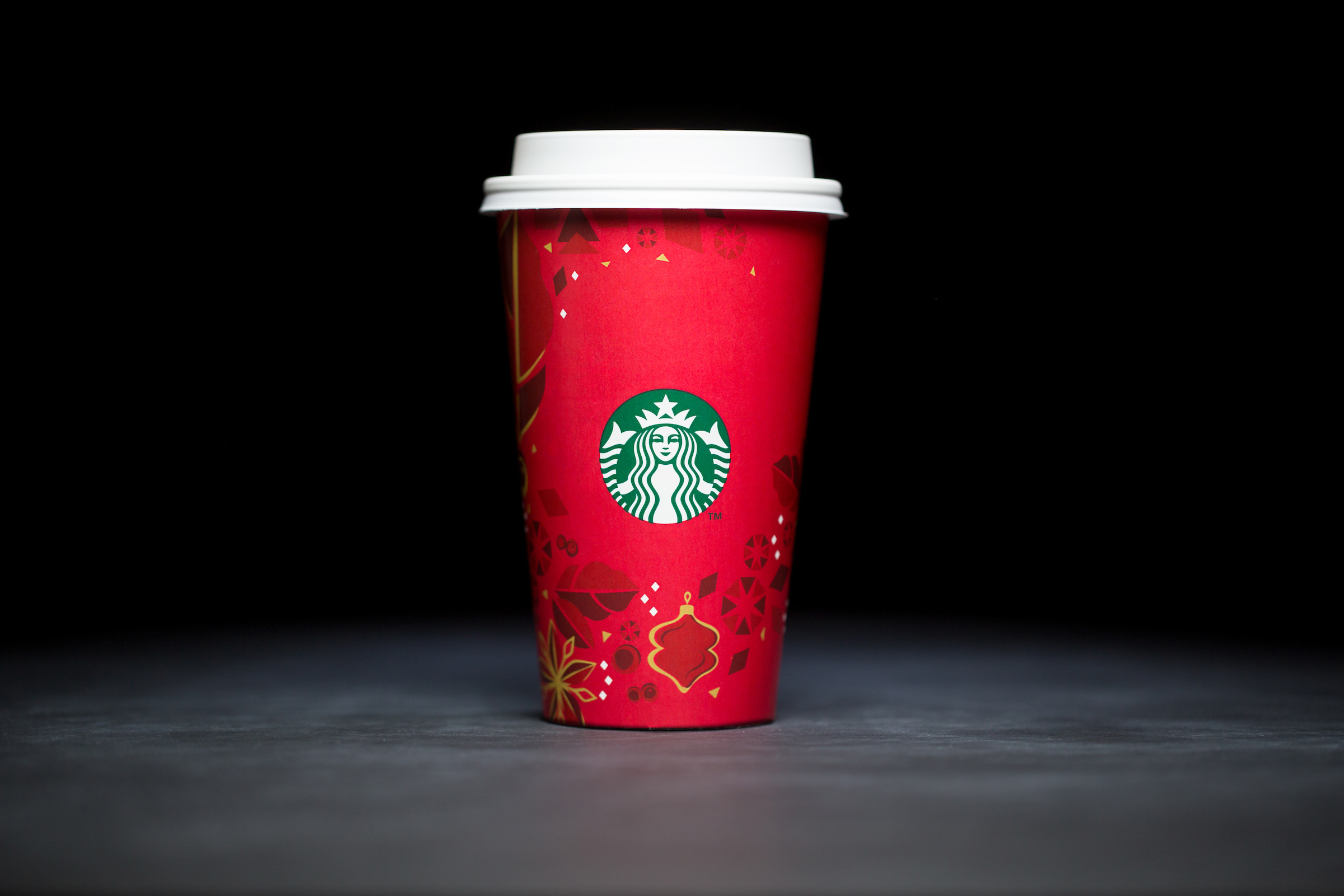 2013: For 20 years, Starbucks have released a range of holiday cup designs, most of them based around their world famous red cup. It's not easy to find the very first Starbucks holiday cups, which made their debut in stores in 1997. Few were saved, and electronic design files were lost in an earthquake in 2001. Even an Internet search is unyielding, with the cups having made their arrival long before the first selfie. But, we have them here! Click on for a photos of all 20 holidays cup designs. (Image: Joshua Trujillo/Cover Images)