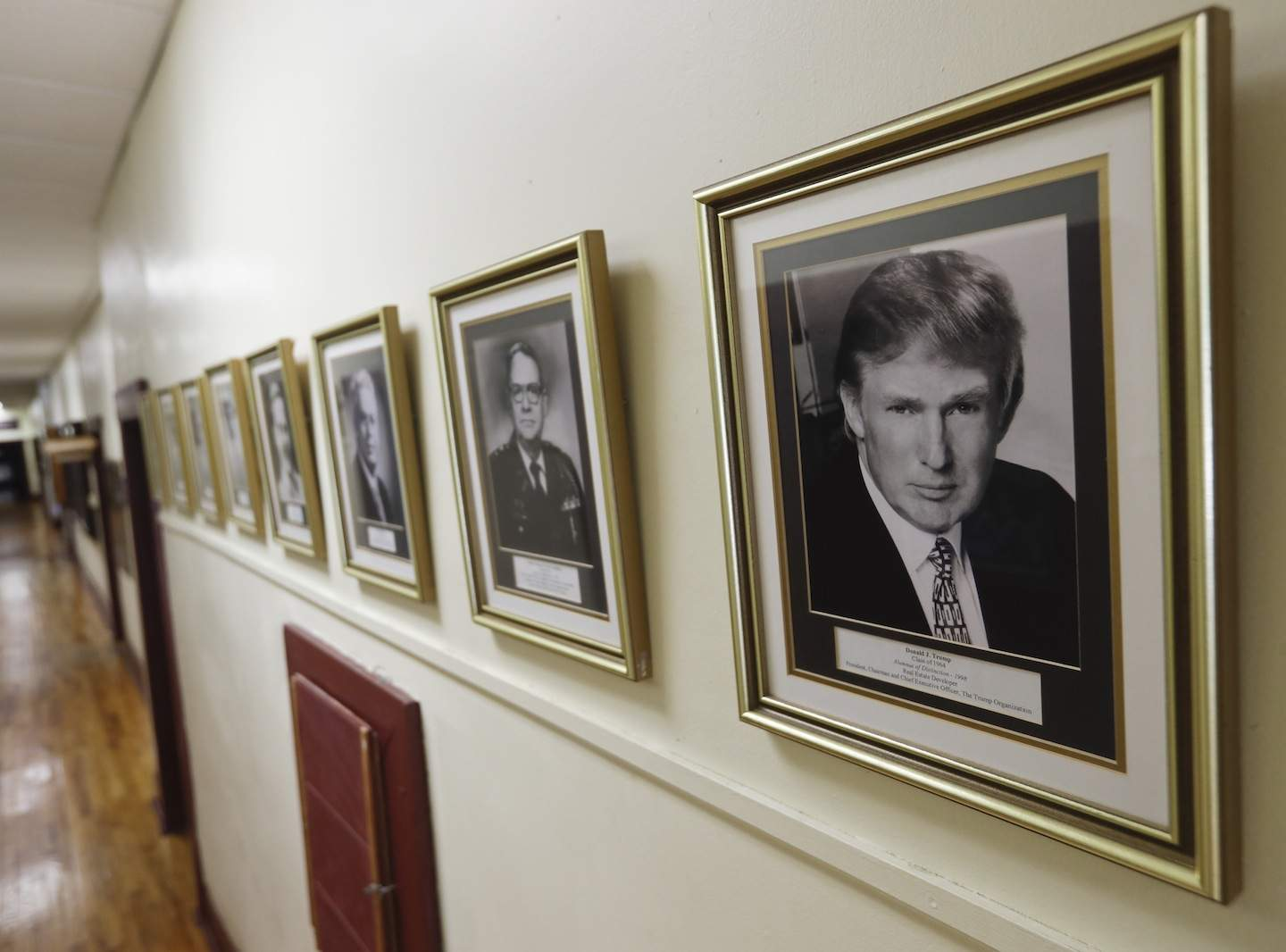 In this Thursday, Sept. 8, 2016 photo, a portrait of Donald Trump hangs on the wall at the New York Military Academy, in Cornwall-on-Hudson, N.Y. Trump talks tough about dealing with China, but his alma mater is looking to Asia to survive. The school has reopened after a rough patch with new Chinese owners and a new superintendent who emigrated from China before making her mark in the New York City school system. (AP Photo/Mike Groll)