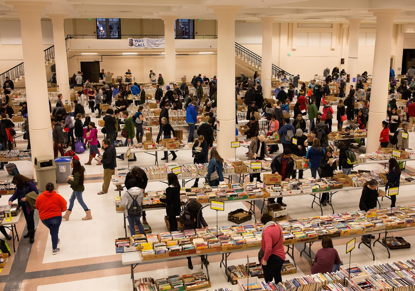 Thousands of book enthusiasts sort through some of the 100,000 titles for sale at the Big Book Sale 2017, put on by the Friends of The Seattle Public Library. Over 1,000 attendess flooded the doors in the first 45 minutes on Saturday morning. (Sy Bean / Seattle Refined)