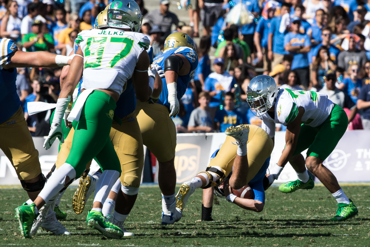 Oregon linebacker Troye Dye (#35) sacks UCLA quarterback Josh Rosen (#3).  The Oregon Ducks rallied during the second quarter to go into halftime tied 14-14 with the UCLA Bruins at Rose Bowl Stadium in Pasadena, California. Photo by Austin Hicks, Oregon News Lab