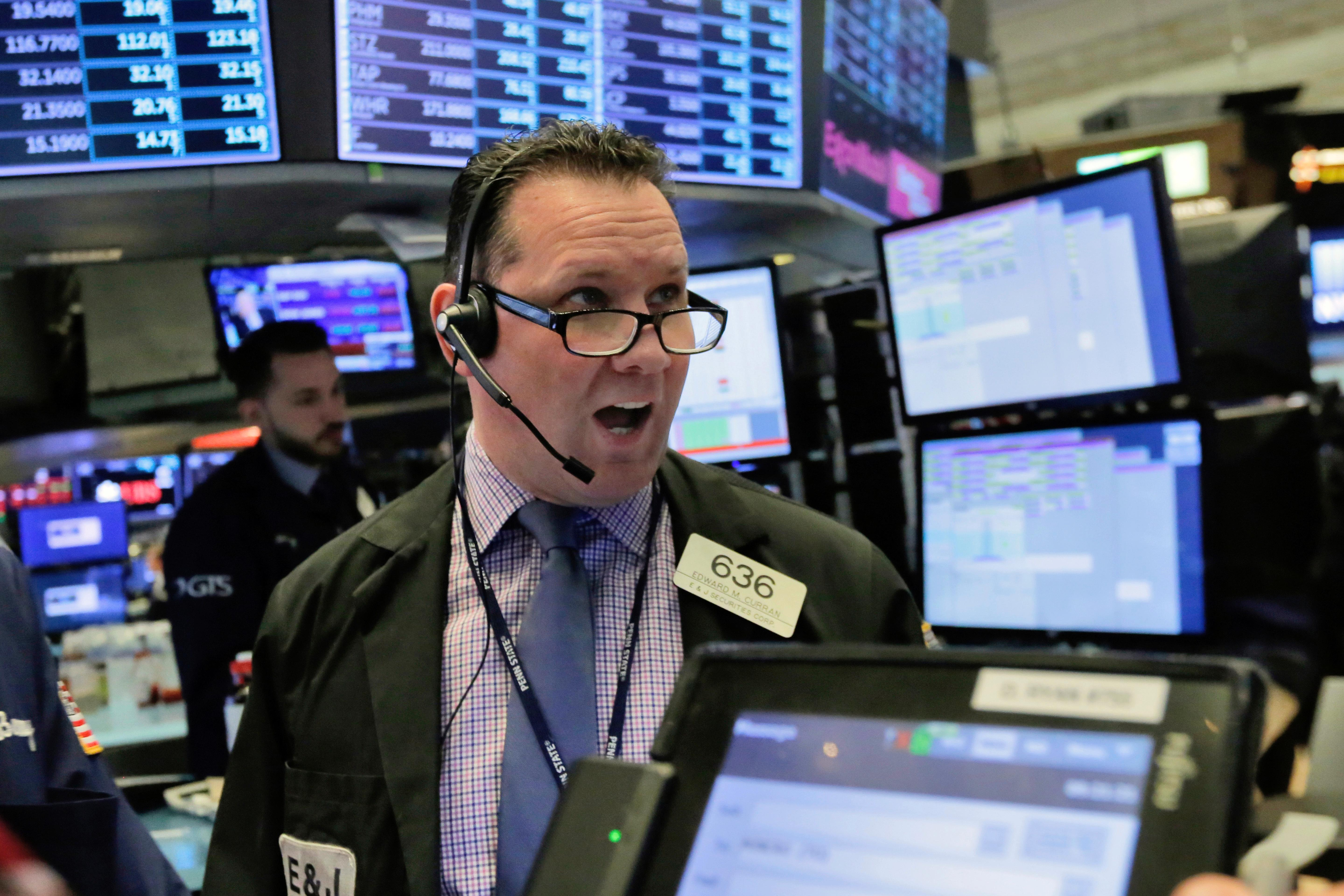 Trader Edward Curran works on the floor of the New York Stock Exchange, Tuesday, Feb. 6, 2018. The Dow Jones industrial average fell as much as 500 points in early trading, bringing the index down 10 percent from the record high it reached on Jan. 26. The DJIA quickly recovered much of that loss. (AP Photo/Richard Drew)