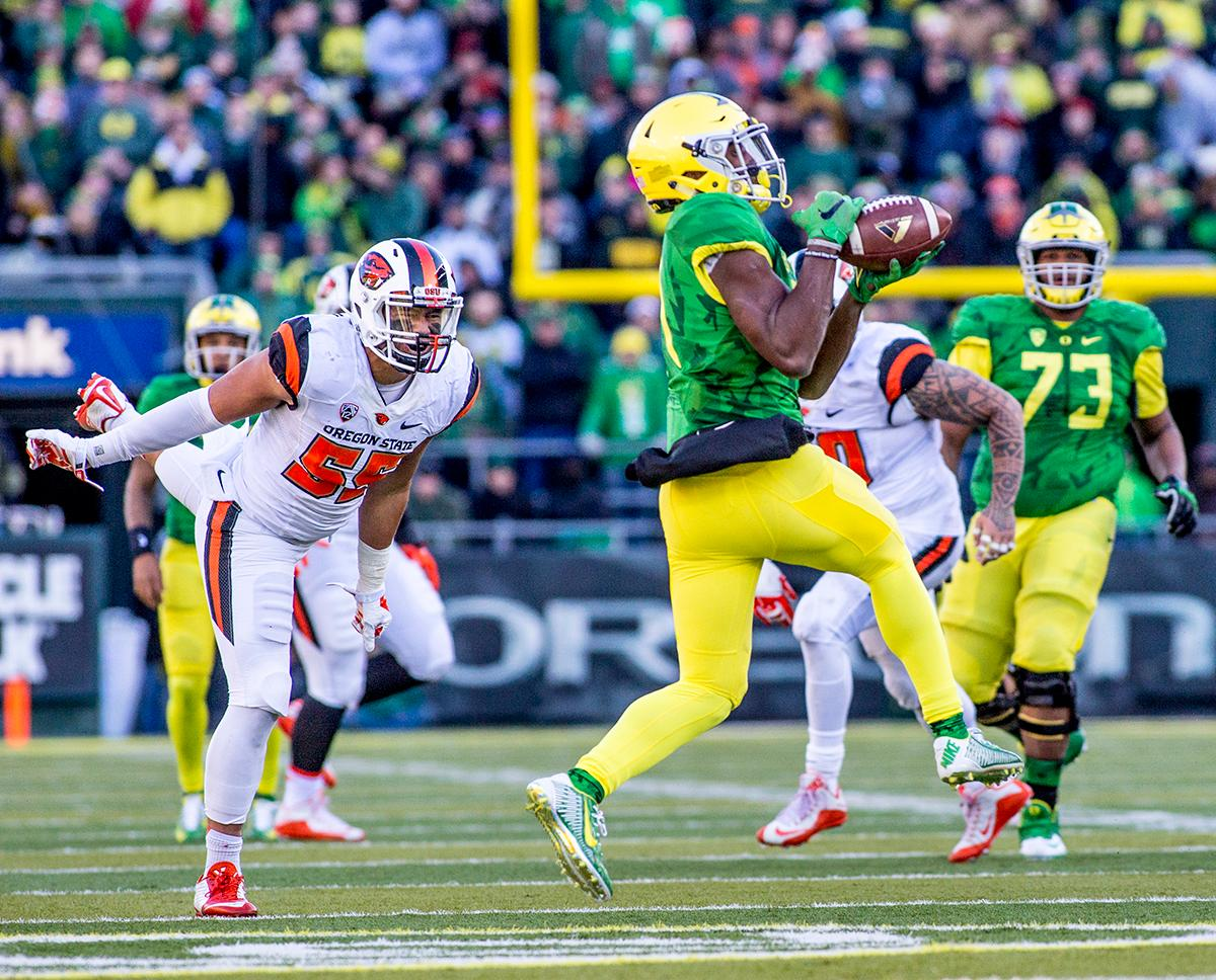 Oregon Ducks receiver pulls in a pass in Autzen Stadium. At the half the Ducks led the Beavers 31 - 7. Photo by Katie Pietzold, Oregon News Lab