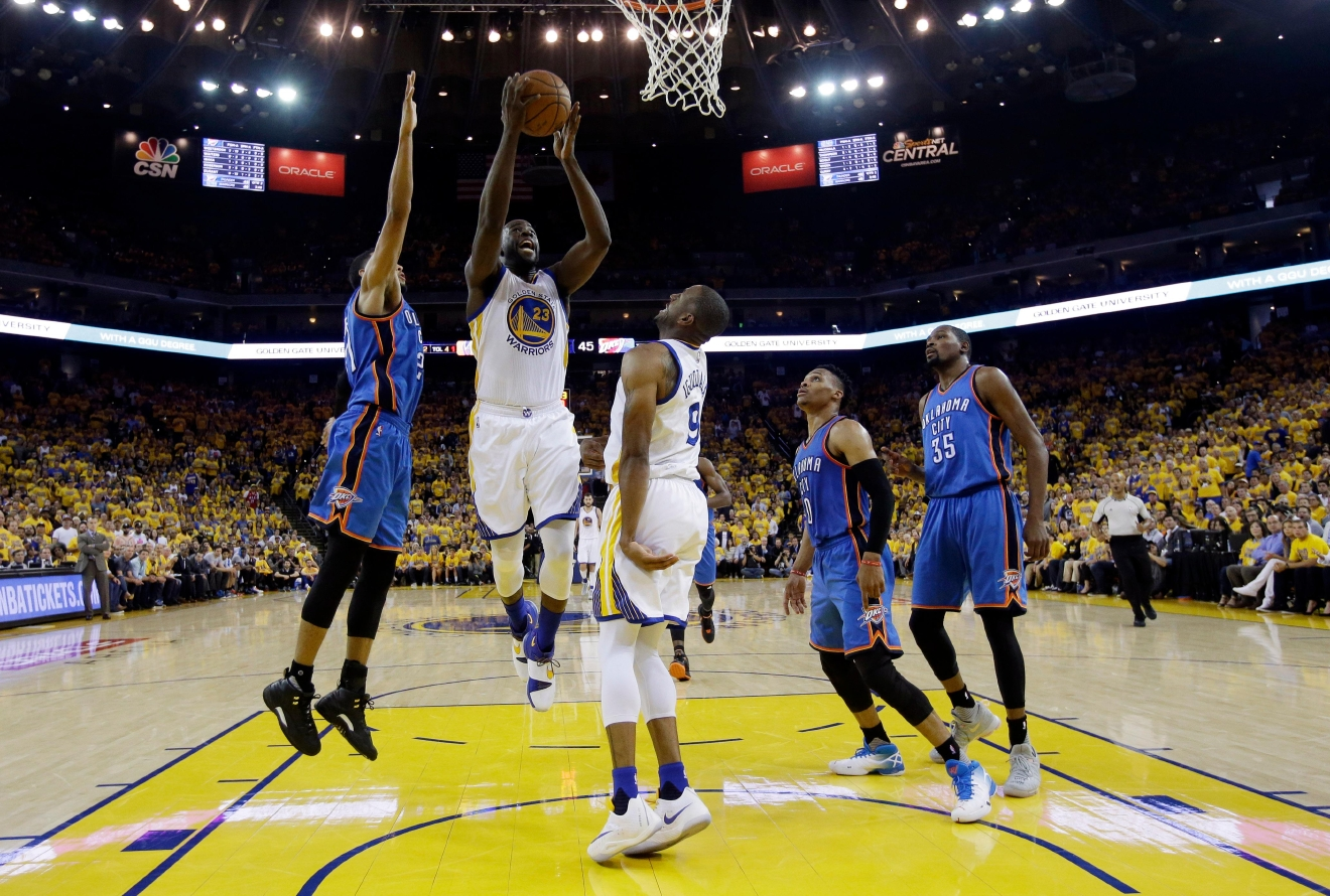 Golden State Warriors' Draymond Green (23) goes up for a shot against the Oklahoma City Thunder during the first half in Game 5 of the NBA basketball Western Conference finals Thursday, May 26, 2016, in Oakland, Calif. (AP Photo/Marcio Jose Sanchez)