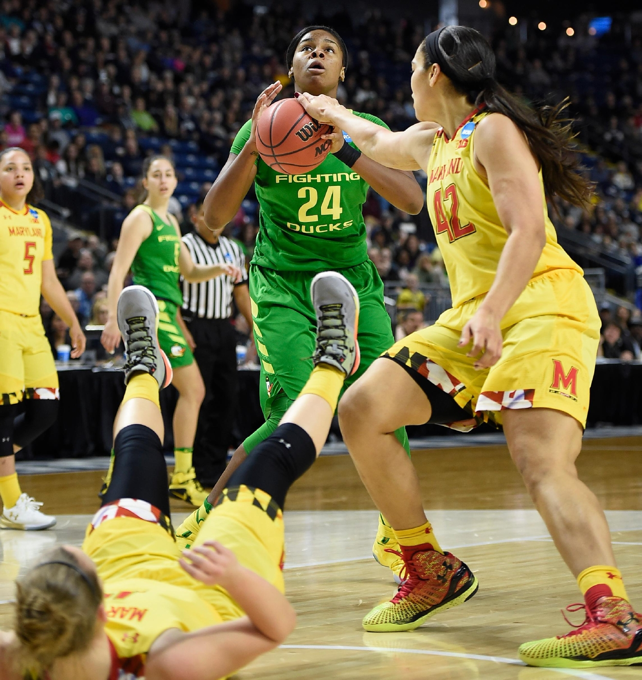 Maryland's Stephanie Jones, right, pressures Oregon's Ruthy Hebard, center, as Maryland's Kristen Confroy, left, falls to the court, during the first half of a regional semifinal game in the NCAA women's college basketball tournament, Saturday, March 25, 2017, in Bridgeport, Conn. (AP Photo/Jessica Hill)