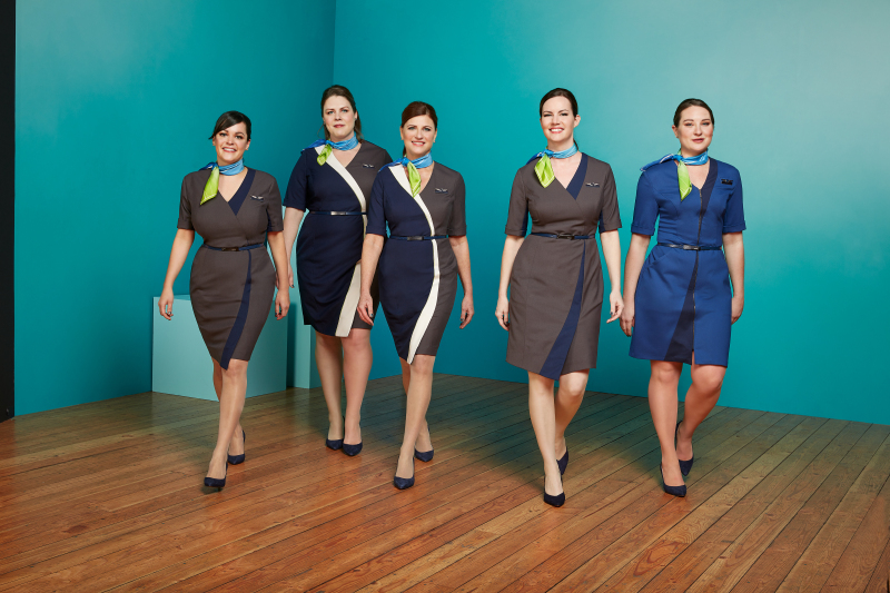 Alaska Airlines flight attendants model various styles being tested over the next 60 days. The flight attendant dresses feature asymmetrical hemlines, pops of color and custom-branded reversible belts. The dresses are complimented by an original Luly Yang scarf. (Photo: Alaska Airlines)