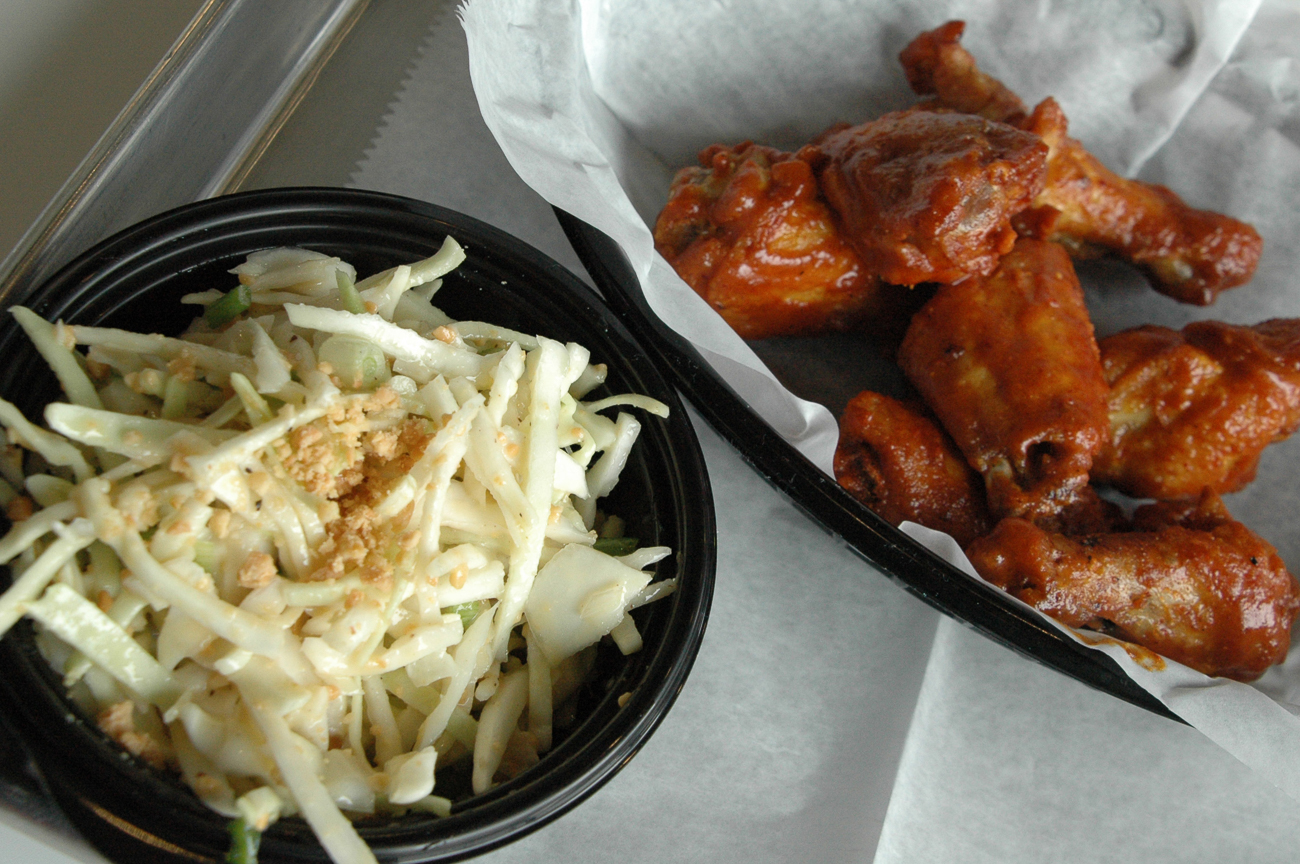 Buffalo wings with cabbage slaw: a surprisingly light lunch that's satisfying on several levels. / Image: Sean Peters // Published: 12.7.18