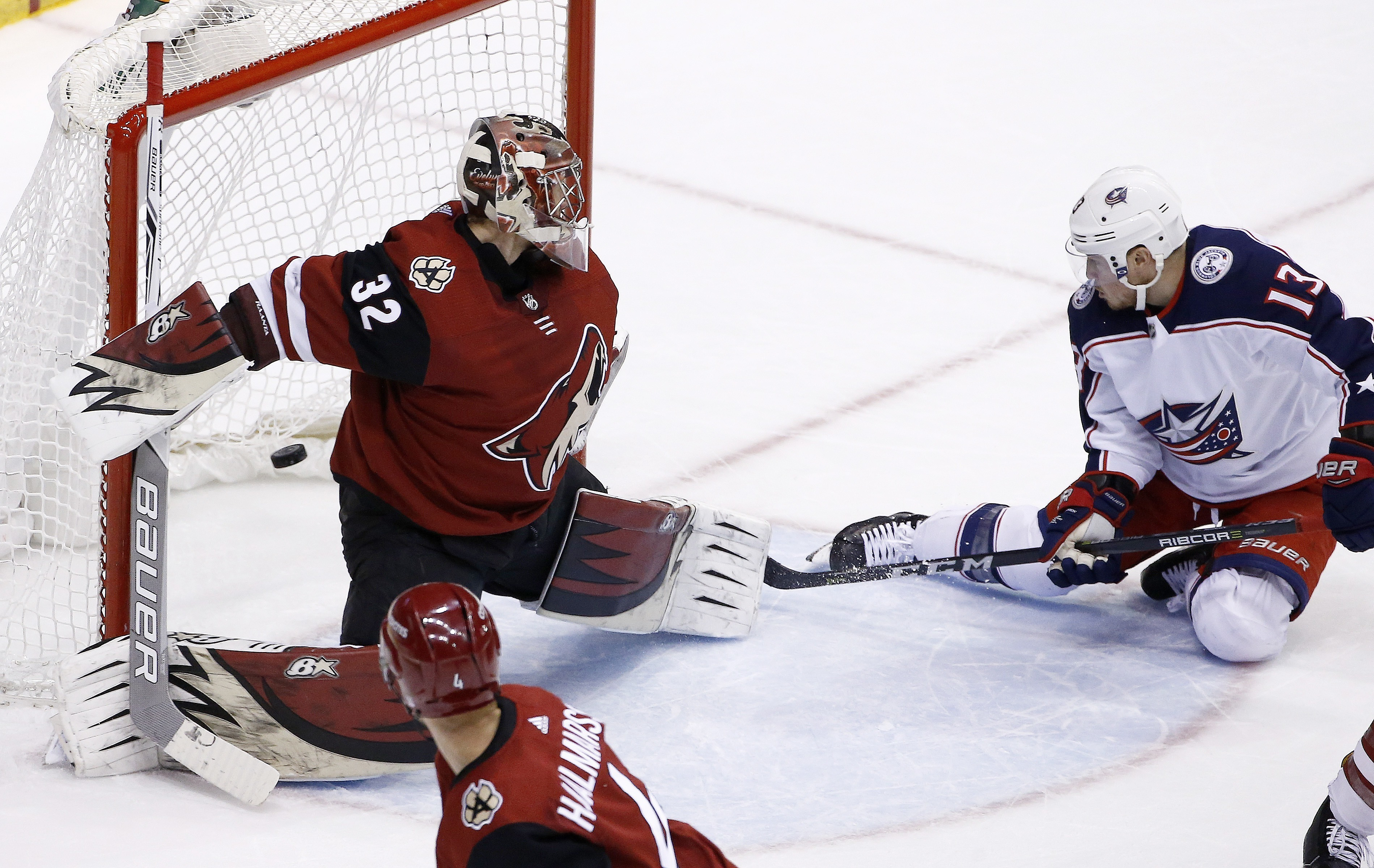 Columbus Blue Jackets right wing Cam Atkinson (13) scores against Arizona Coyotes goaltender Antti Raanta (32) during the third period of an NHL hockey game Thursday, Jan. 25, 2018, in Glendale, Ariz. The Blue Jackets won 2-1. (AP Photo/Ross D. Franklin)