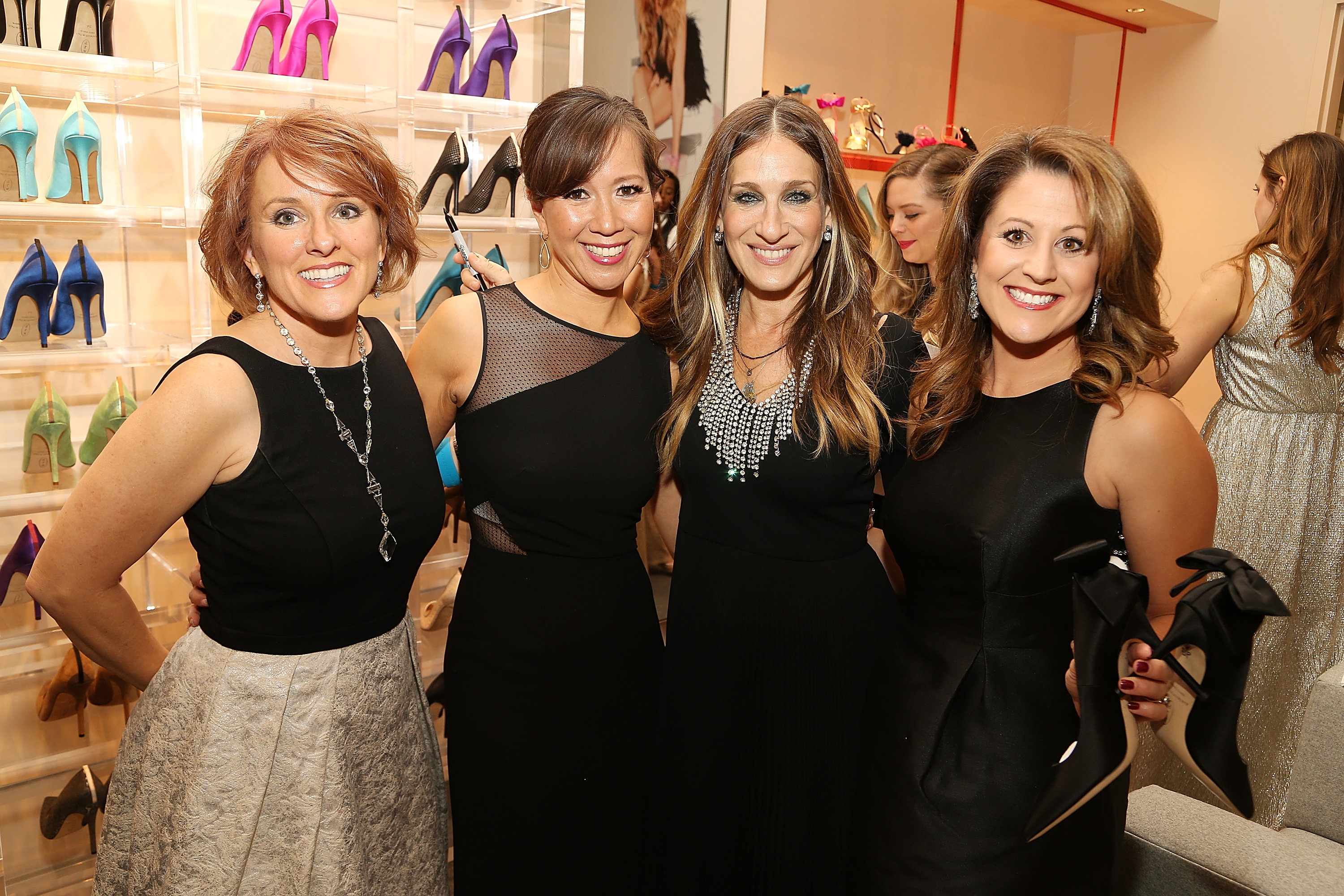 Sarah Jessica Parker with shoppers at the MGM National Harbor Grand Opening Gala on December 8, 2016 in National Harbor, Maryland.  Parker opened her first brick and mortar store inside the MGM National Harbor in December 2016. (Photo by Paul Morigi/Getty Images for MGM National Harbor)