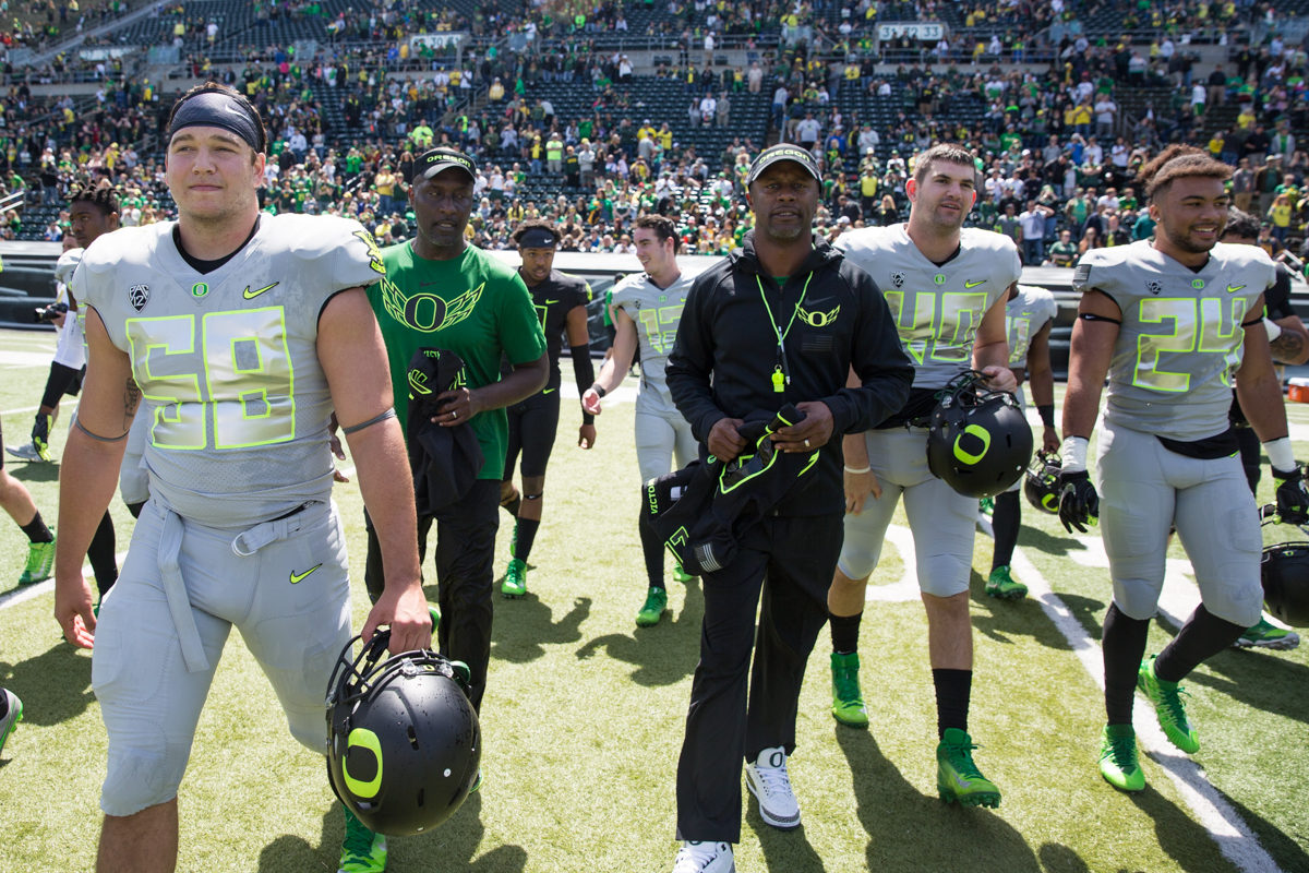 Oregon Ducks Head Coach Willie Taggart leads his team onto the field to exchange uniforms with US Military Servicemembers. The 2017 Oregon Ducks Spring Game provided fans their first look at the team under new Head Coach Willie Taggart's direction.  Team Free defeated Team Brave 34-11 on a sunny day at Autzen Stadium in Eugene, Oregon.  Photo by Austin Hicks, Oregon News Lab