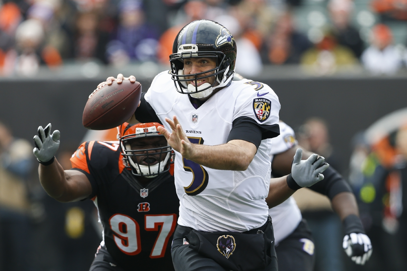 Baltimore Ravens quarterback Joe Flacco (5) looks to pass under pressure from Cincinnati Bengals defensive tackle Geno Atkins (97) in the first half of an NFL football game, Sunday, Jan. 1, 2017, in Cincinnati. (AP Photo/Gary Landers)
