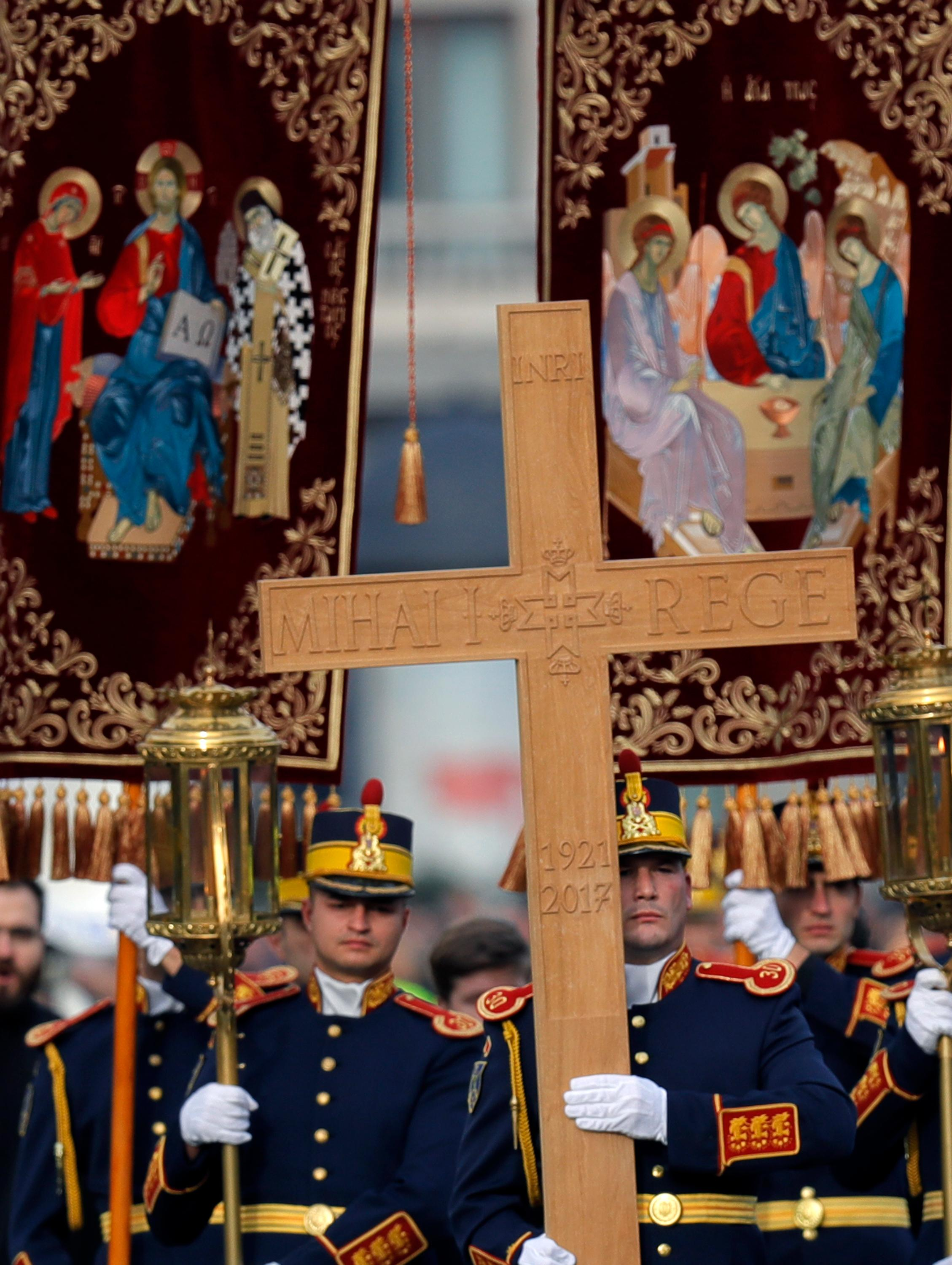 Honor guard soldiers perform during the funeral ceremony in tribute to late Romanian King Michael in Bucharest, Romania, Saturday, Dec.16, 2017. Tens of thousands of Romanians joined the European royals on Saturday to pay their respects to late King Michael as a state funeral got underway. Michael, who ruled Romania twice before being forced to abdicate by the communists in 1947, died at the age of 96 in Switzerland this month. (AP Photo/Vadim Ghirda)