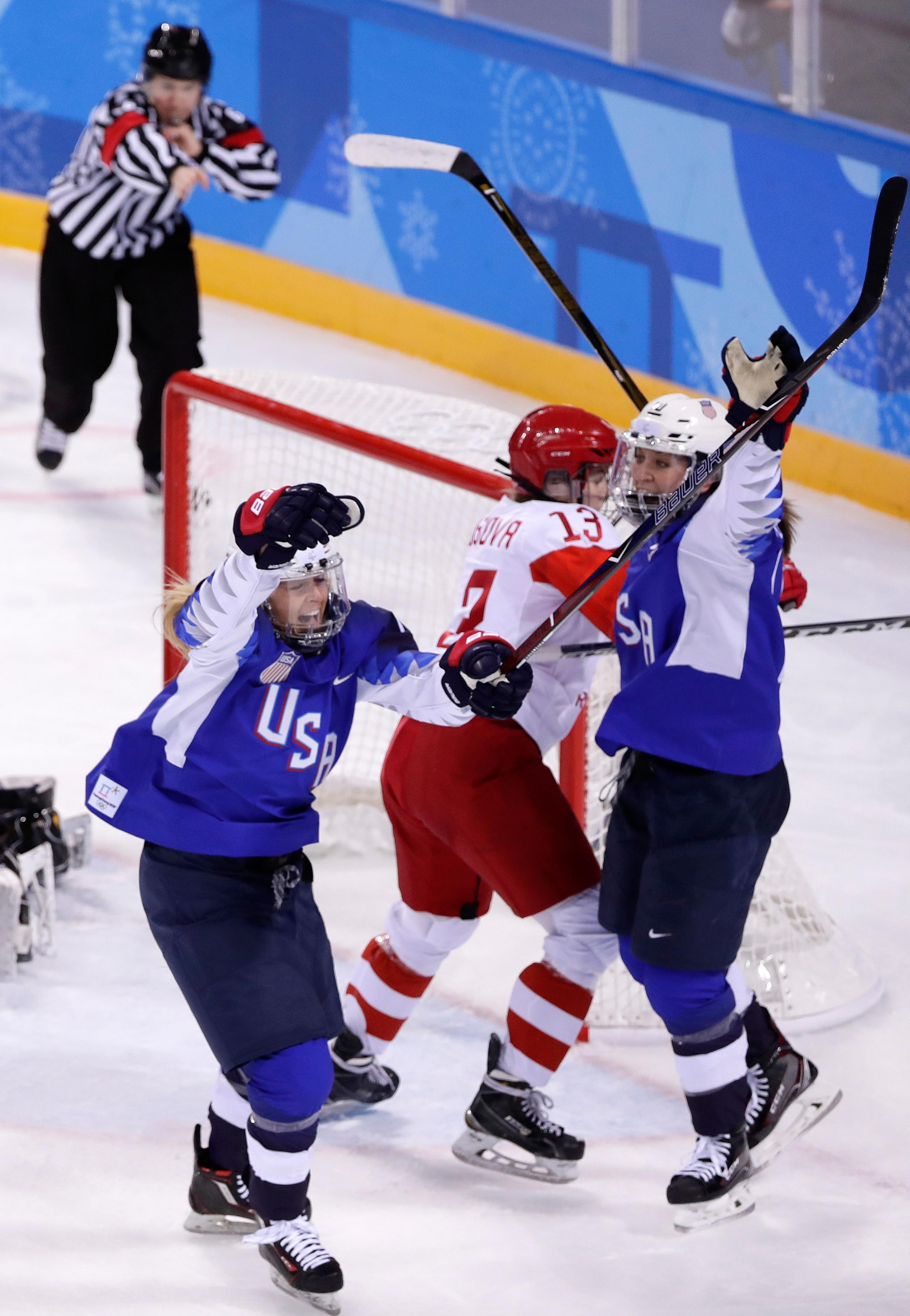Gigi Marvin, left, of the United States, reacts after scoring a goal during the second period of the preliminary round of the women's hockey game against the team from Russia at the 2018 Winter Olympics in Gangneung, South Korea, Tuesday, Feb. 13, 2018. (AP Photo/Frank Franklin II)