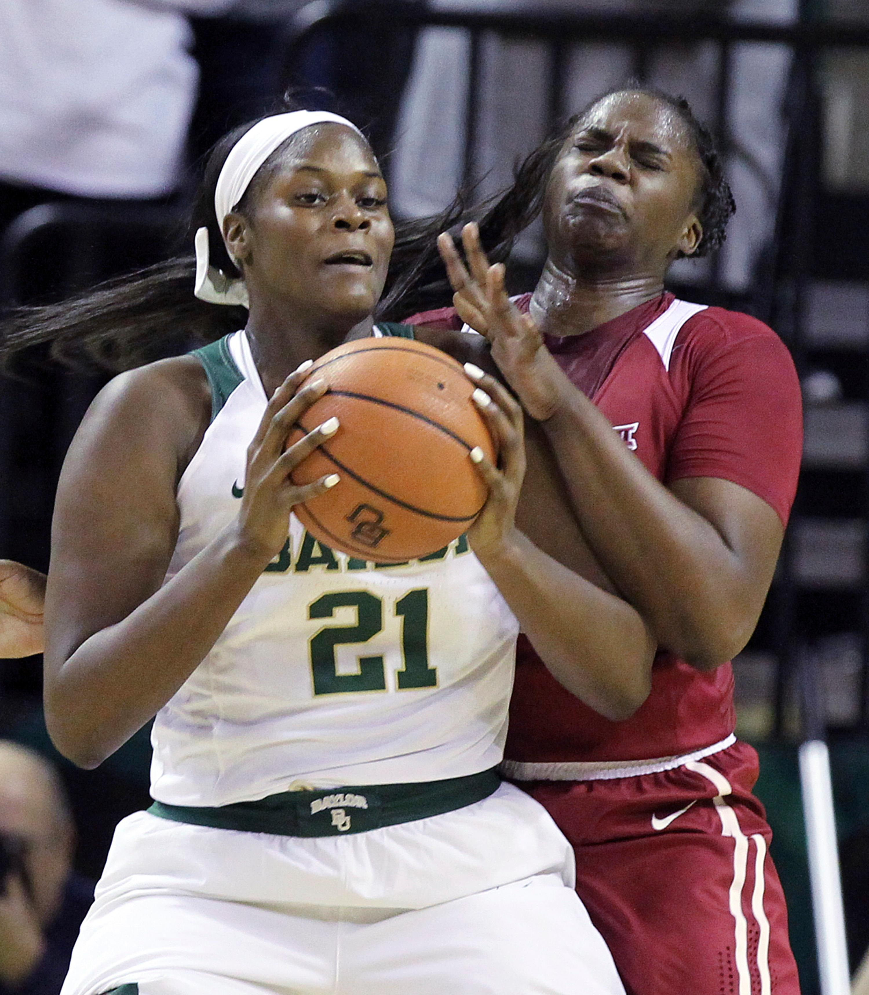 Baylor center Kalani Brown, left, tries to score past Oklahoma center Vionise Pierre-Louis, right, during the first half of an NCAA college basketball game, Monday, Feb. 5, 2018, in Waco, Texas. (AP Photo/Jerry Larson)