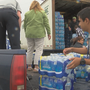 English students from Davis High School help donate water bottle to Camp Hope