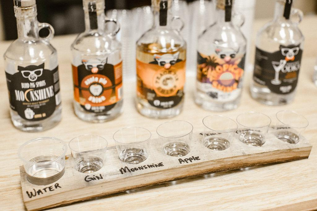 Blind Pig Spirits in-house distillery at 222 Market features a tasting room, production and bottling facility, and retail sales of their products and branded merchandise.(PHOTO: OLYSOCIAL and Poppi Photography).