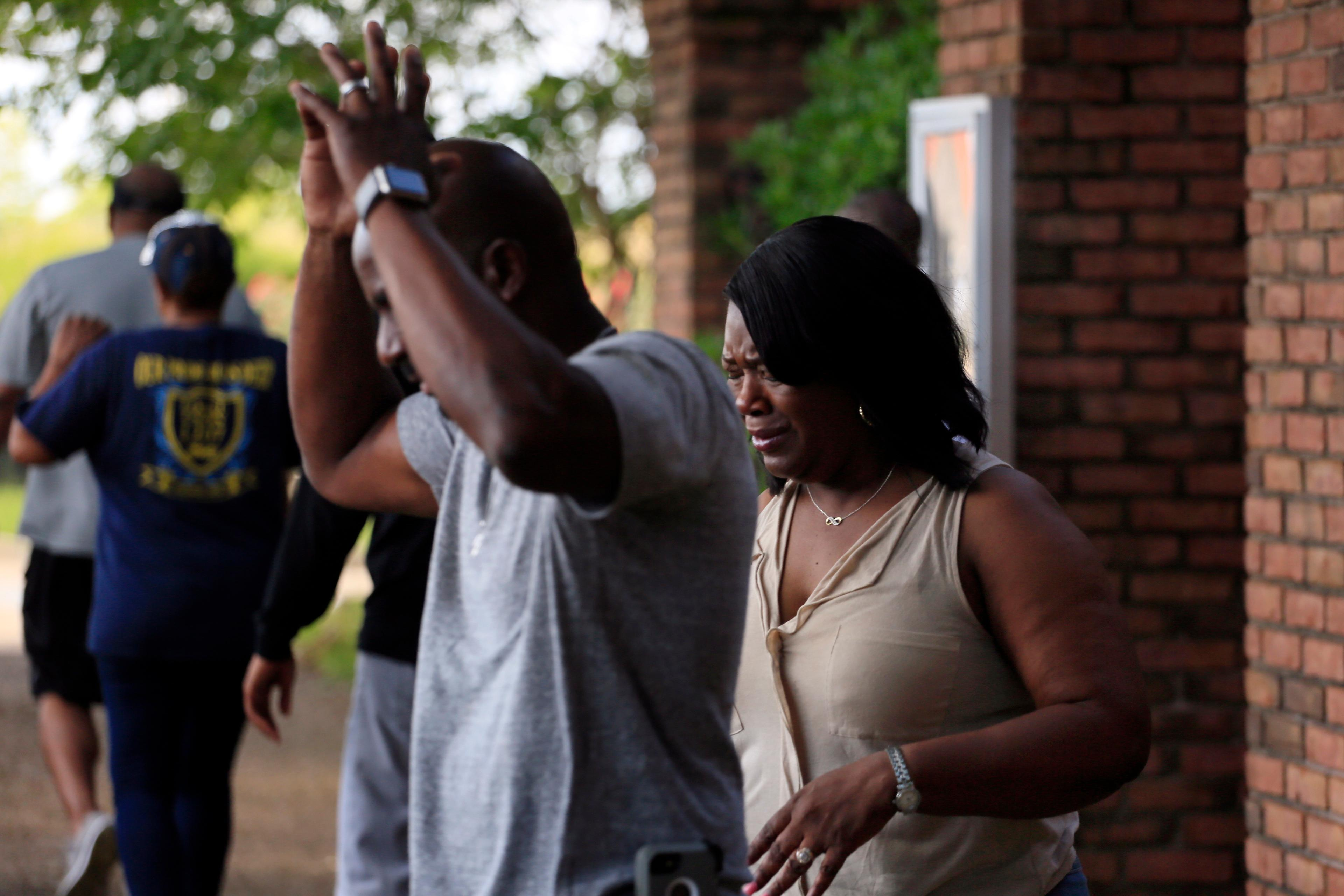 Family members react after learning that Kingston Frazier was found dead after being kidnapped during the theft of his mother's vehicle from a Kroger parking lot Thursday, May 18, 2017, in Jackson, Miss. (Elijah Baylis/The Clarion-Ledger via AP)