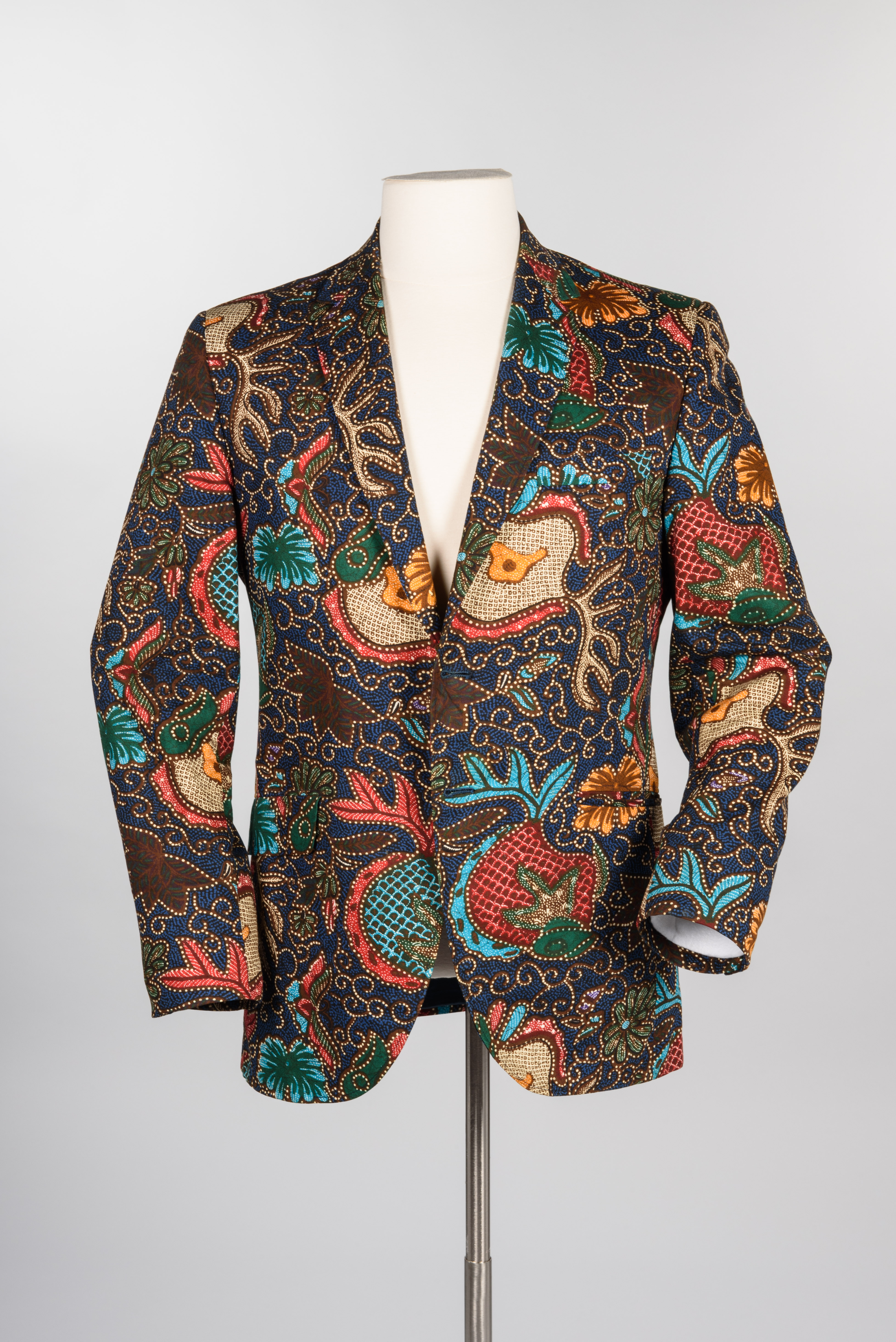 Batik print jacket with pants, tie, shirt and cufflinks, about 1967. Gift of John Doyle Bishop copyright MOHAI Collection.{ }