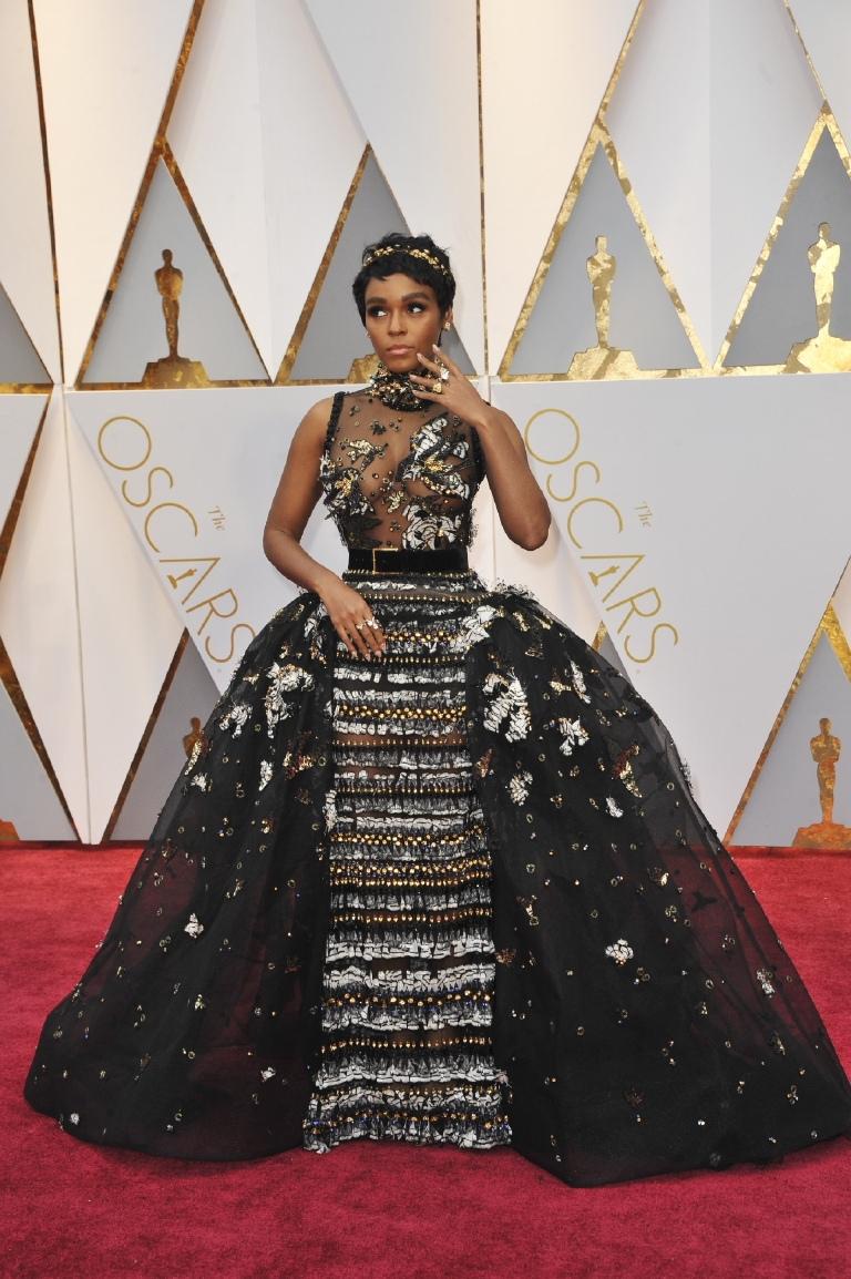 I have seen  this dress land on both best and worst dressed lists but for me it was a definite YASS girl, and possibly my favorite look of the night. I love that Janelle went bold for her first trip to the Oscars in a fairy-tale, diamond-encrusted gown, topped off with a princess-y headband. The entire look was ethereal. (Image: Apega/WENN.com)