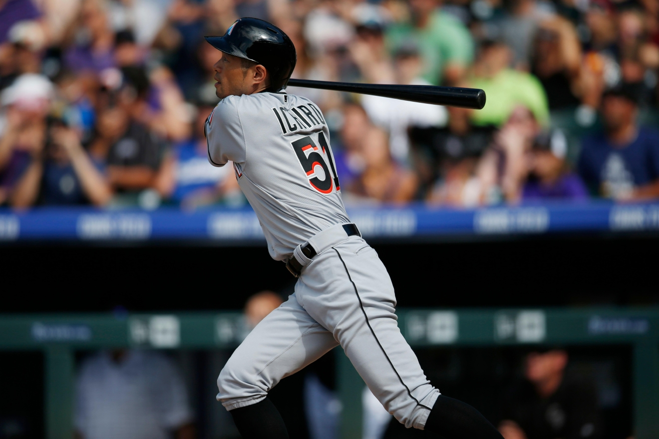 Miami Marlins' Ichiro Suzuki follows the flight of his triple off Colorado Rockies starting pitcher Chris Rusin in the seventh inning of a baseball game, Sunday, Aug. 7, 2016 in Denver. The hit was the 3,000th in his Major League career. (AP Photo/David Zalubowski)