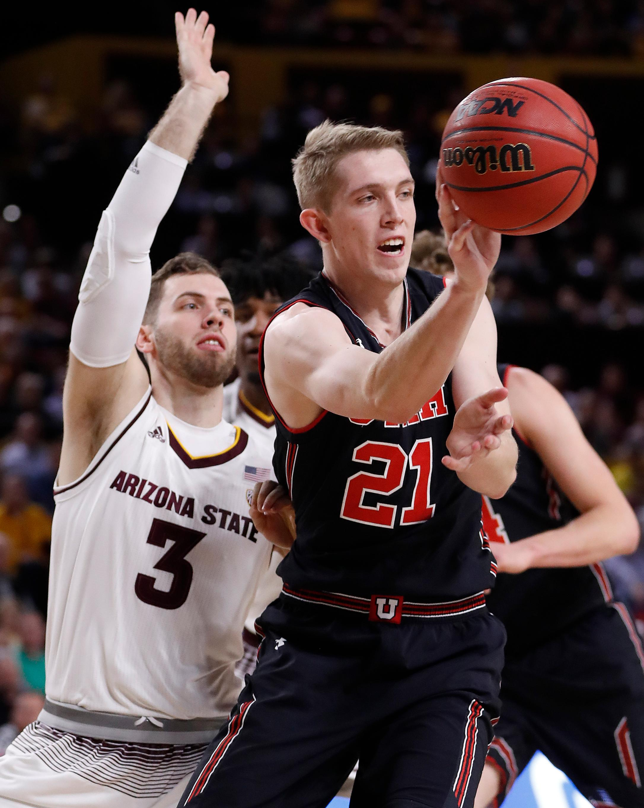 Utah forward Tyler Rawson (21) passes as Arizona State forward Mickey Mitchell (3) defends during the first half of an NCAA college basketball game, Thursday, Jan. 25, 2018,in Tempe, Ariz. (AP Photo/Matt York)