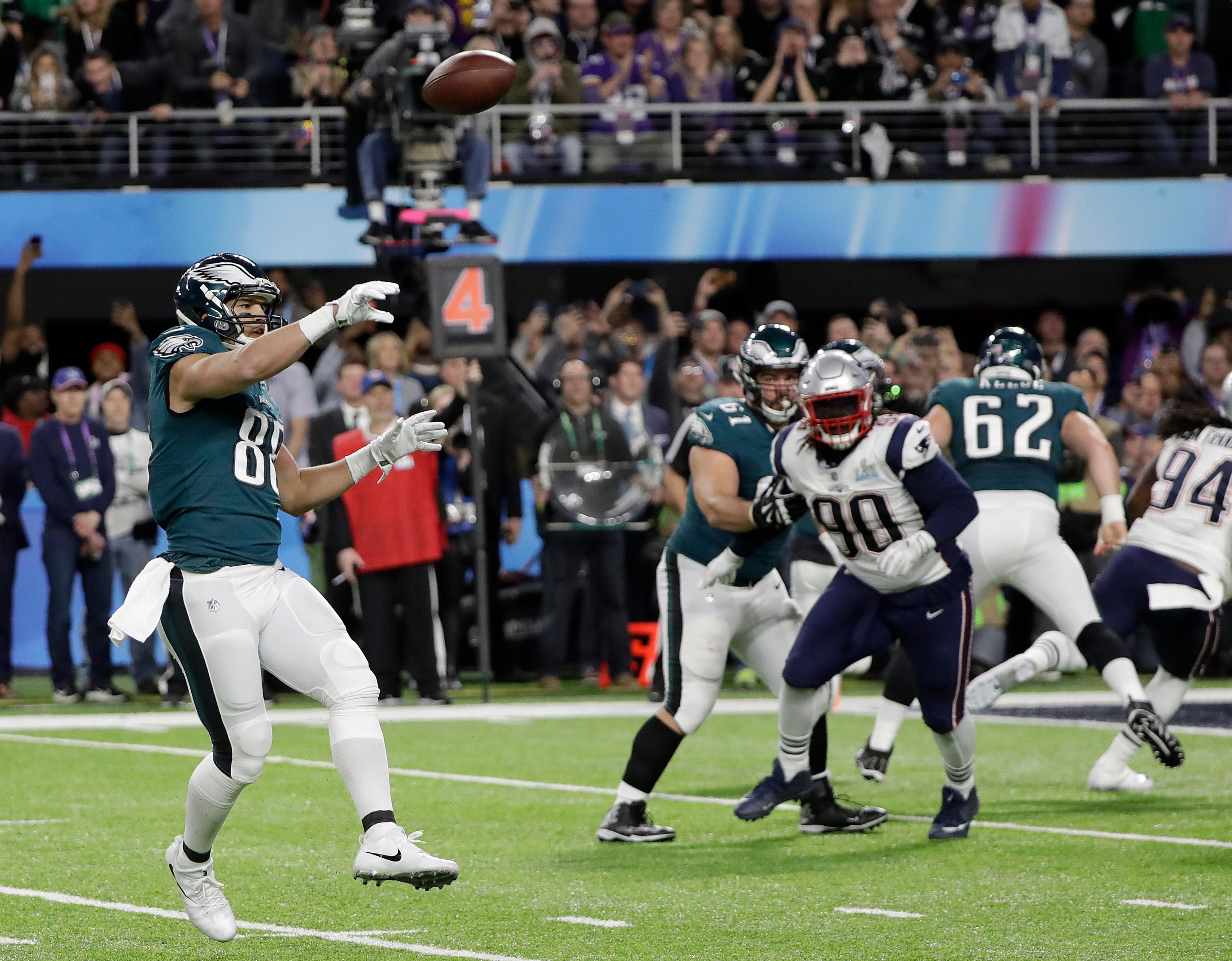 Philadelphia Eagles' Trey Burton, left, throws a touchdown pass to Nick Foles during the first half of the NFL Super Bowl 52 football game against the New England Patriots Sunday, Feb. 4, 2018, in Minneapolis. (AP Photo/Mark Humphrey)