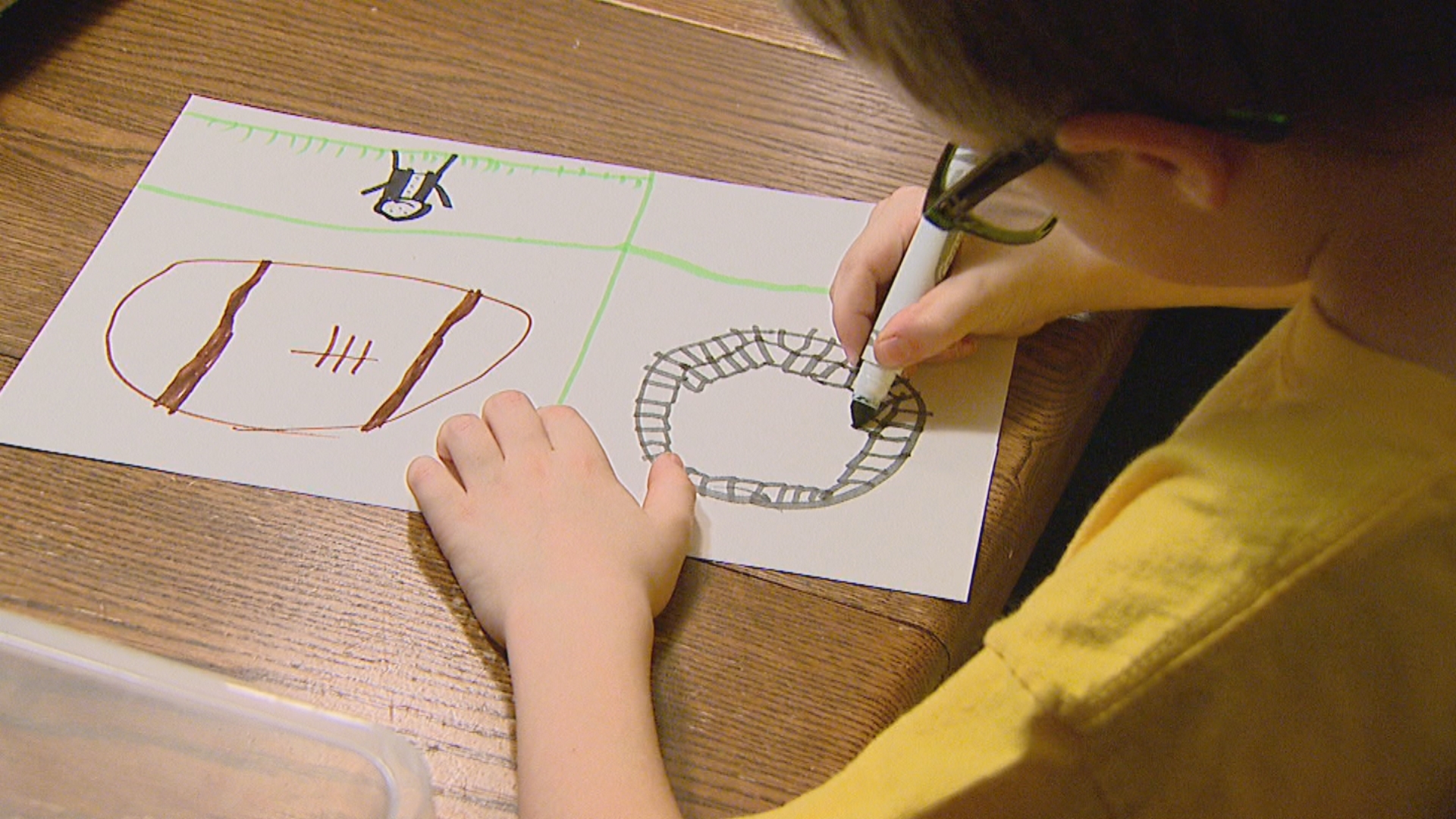 David Gelb drawing a picture. The 7-year-old Allouez boy is raising donations through his artwork for Children's Hospital of Wisconsin. (WLUK/Jesse Basinski)