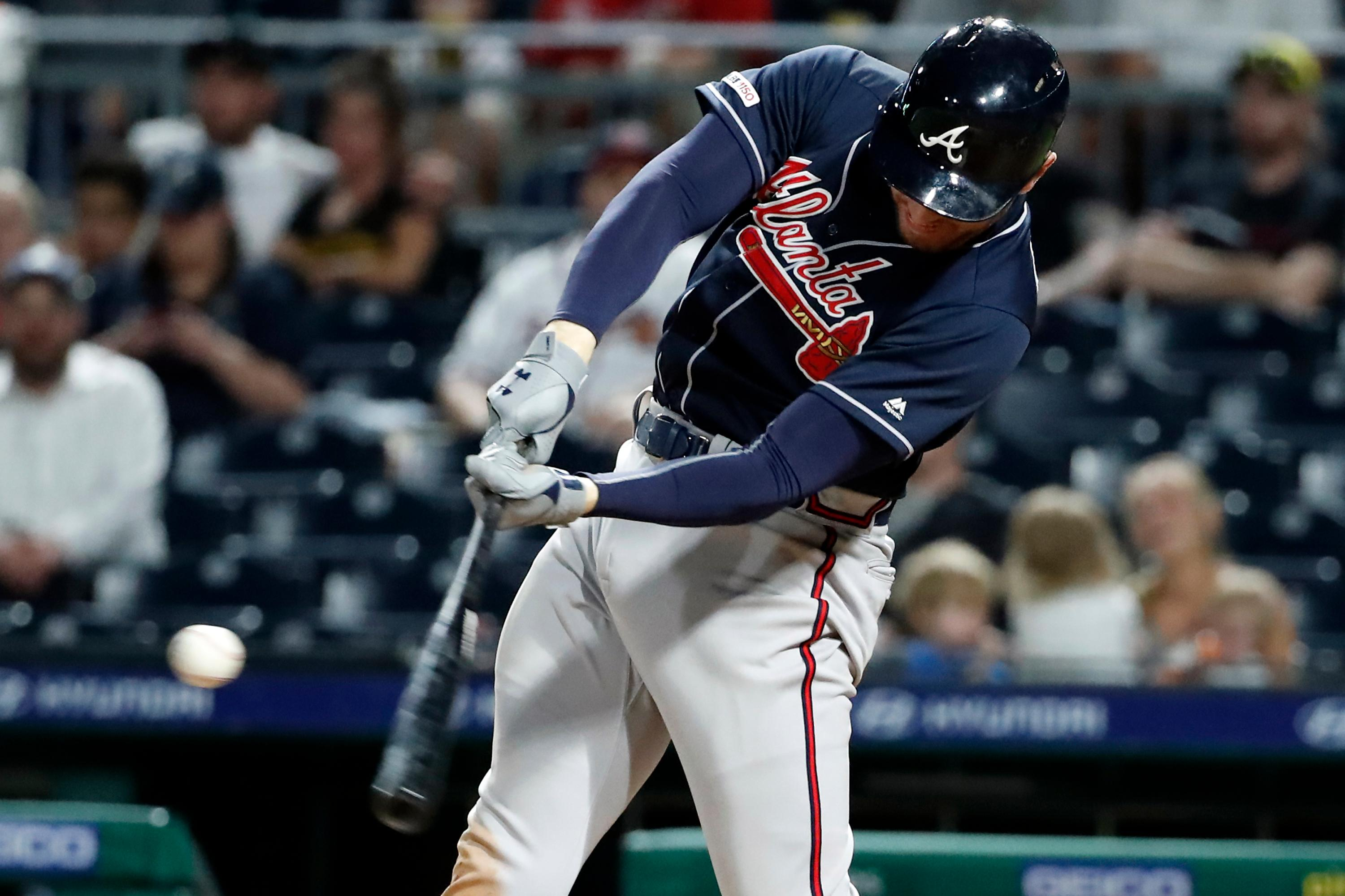 Atlanta Braves' Freddie Freeman hits a two-run home run off Pittsburgh Pirates' Rookie Davis during the ninth inning of a baseball game in Pittsburgh, Tuesday, June 4, 2019. The Braves won 12-5. (AP Photo/Gene J. Puskar)