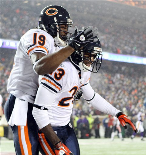 Chicago Bears' Devin Hester (23) is congratulated by Devin Aromashodu (19) after Hester ran back a punt 64 yards for a touchdown. / AP photo