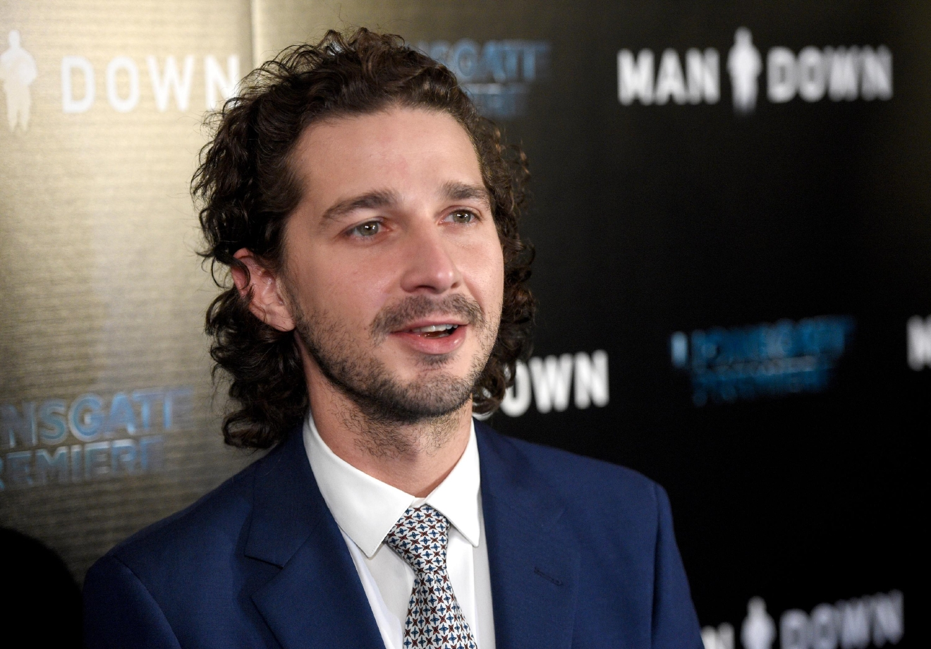 "FILE - In this Nov. 30, 2016 file photo, Shia LaBeouf arrives at the Los Angeles premiere of ""Man Down"" at ArcLight Cinemas Hollywood. LaBeouf has been arrested early Thursday morning, Jan. 26, 2017, after he allegedly got into an altercation with another man outside a New York City museum. Police say LaBeouf pulled the scarf of an unidentified 25-year-old man early Thursday morning outside the Museum of the Moving Image in Queens, scratching his face in the process. (Photo by Chris Pizzello/Invision/AP, File)"