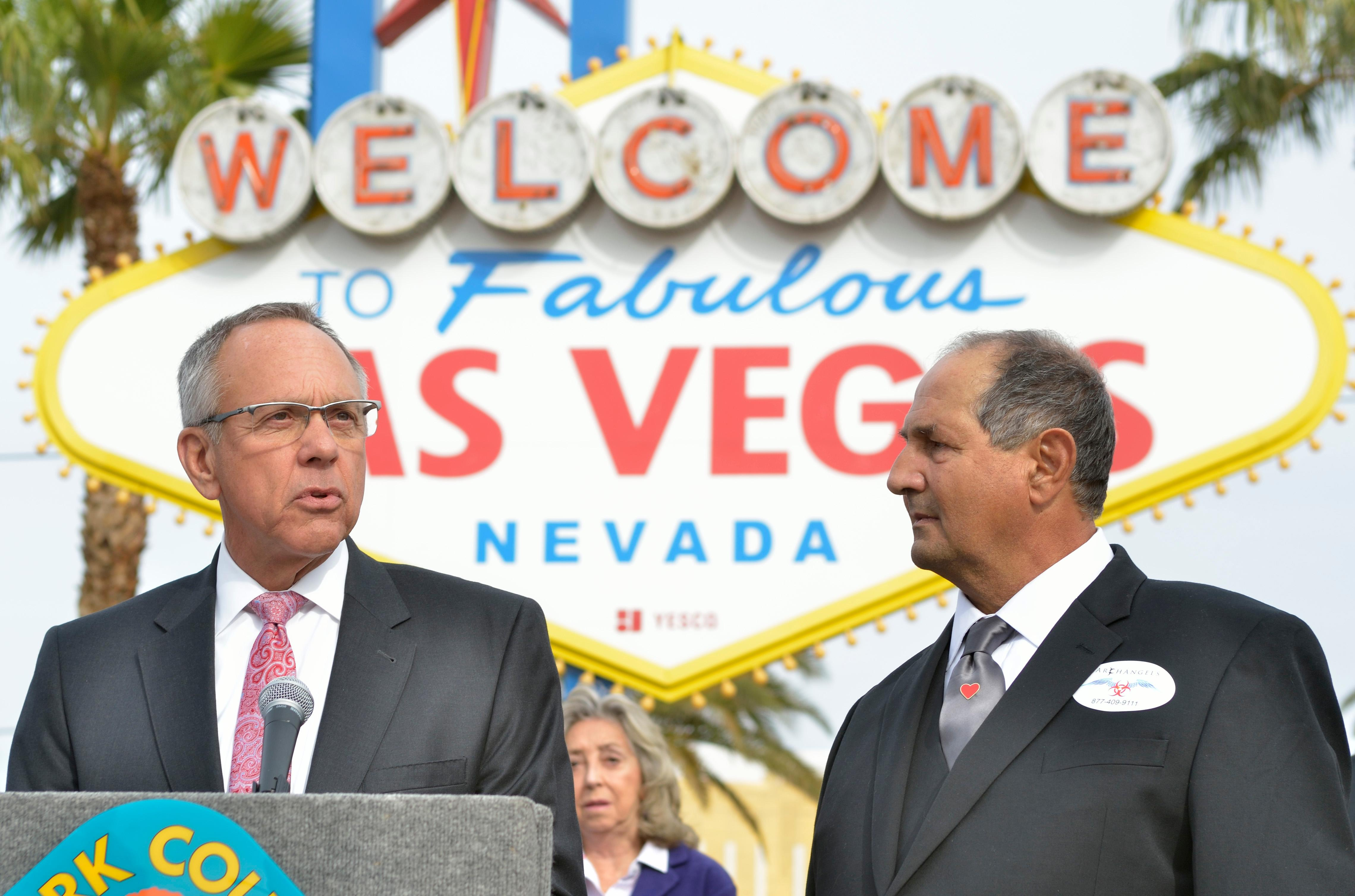 "Clark County Commissioner Jim Gibson, left, speaks as Greg Zanis listens during ""Greg Zanis Day"" at the Welcome to Fabulous Las Vegas sign on the Las Vegas Strip on Sunday, Nov. 12, 2017. Zanis, a carpenter from Aurora, Ill., was recognized by the Clark County Commision for creating 58 crosses memorializing those who died during the Route 91 Harvest festival shooting on Oct. 1. The crosses were later moved to the Clark County Museum for its permanent collection. [Bill Hughes/Las Vegas News Bureau]"