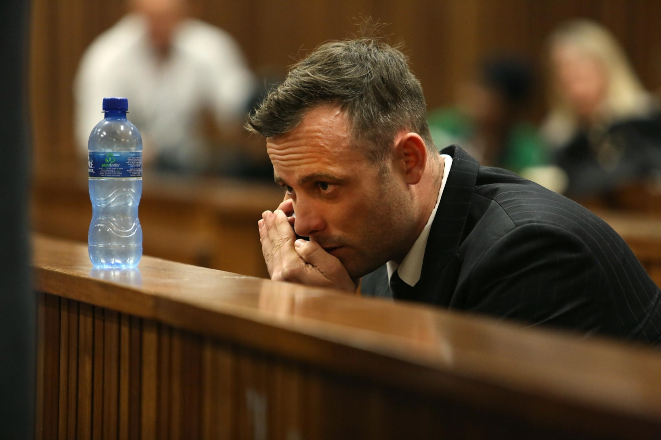 Oscar Pistorius speaks on a mobile phone in the High Court in Pretoria, South Africa, Wednesday, June 15, 2016 on the third day of the double-amputee runner's sentencing hearing for murdering girlfriend Reeva Steenkamp. An appeals court found Pistorius guilty of murder and not a lesser charge of culpable homicide for the shooting death of Steenkamp. (AP Photo/Alon Skuy, Pool via AP)