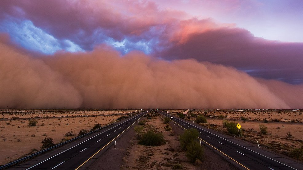 'Holy mother of haboob Batman!' Storm chaser gets incredible footage of massive dust storm