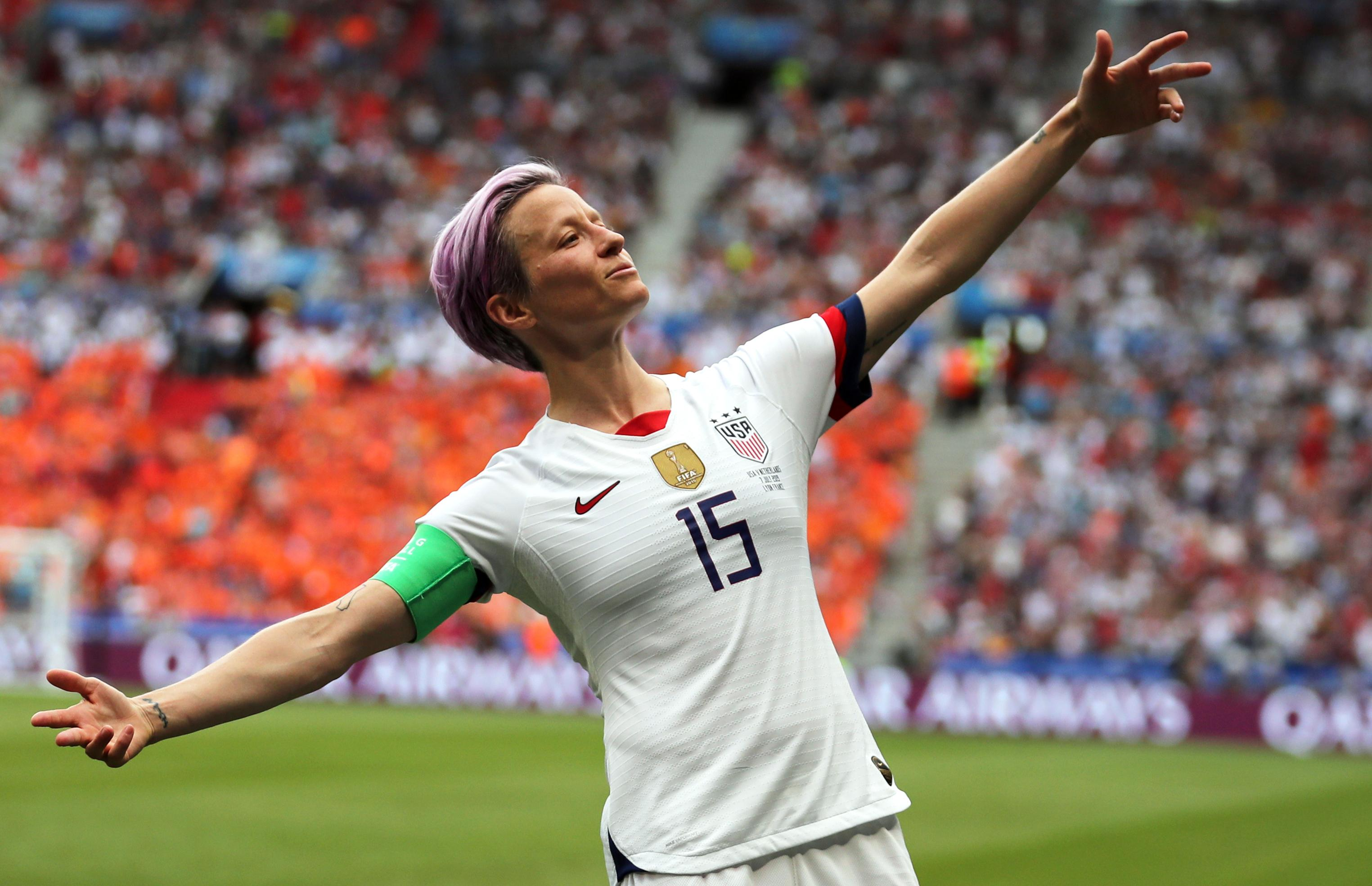 United States' Megan Rapinoe celebrates after scoring the opening goal from the penalty spot during the Women's World Cup final soccer match between US and The Netherlands at the Stade de Lyon in Decines, outside Lyon, France, Sunday, July 7, 2019. (AP Photo/Francisco Seco)