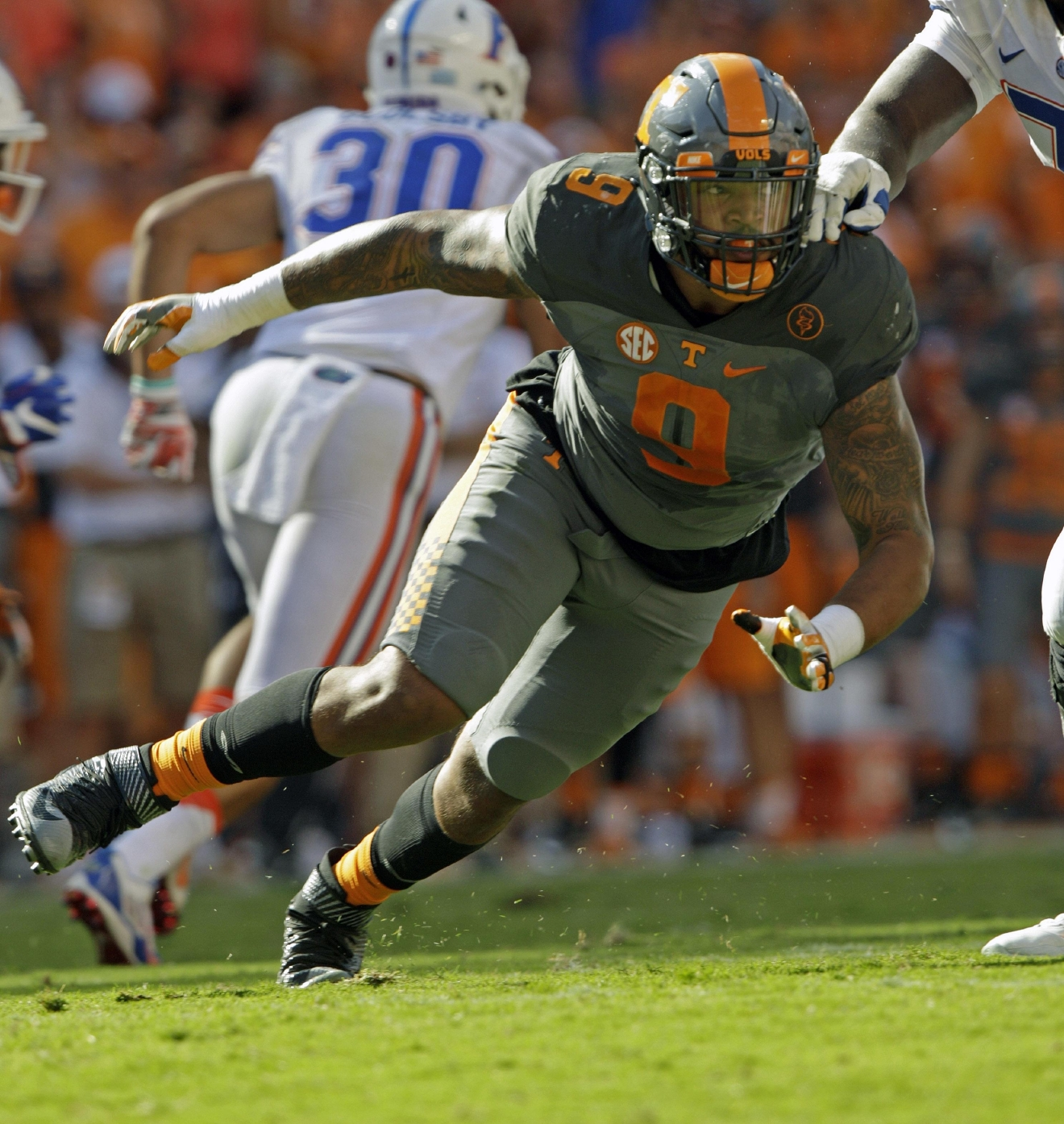 FILE - In this Sept. 24, 2016, file photo, Tennessee defensive end Derek Barnett (9) plays against Florida in an NCAA college football game, in Knoxville, Tenn. Barnett was selected to the 2016 AP All-America college football team, Monday, Dec. 12, 2016.  (AP Photo/Wade Payne, File)
