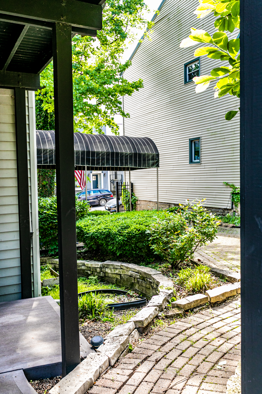 1113 Belvedere Street in Mt. Adams is a three-bedroom, two-bathroom, single-family home with many of its original 1880 features, such as pine floors, the original fireplace and brick, and stained-glass windows. It's also equipped with high-end appliances and updated amenities to make it comfortable for modern life. It is on the market for $399,000. / Image: Amy Spasoff // Published: 5.22.19