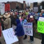 Protesters greet guests of event headlined by Senator Portman