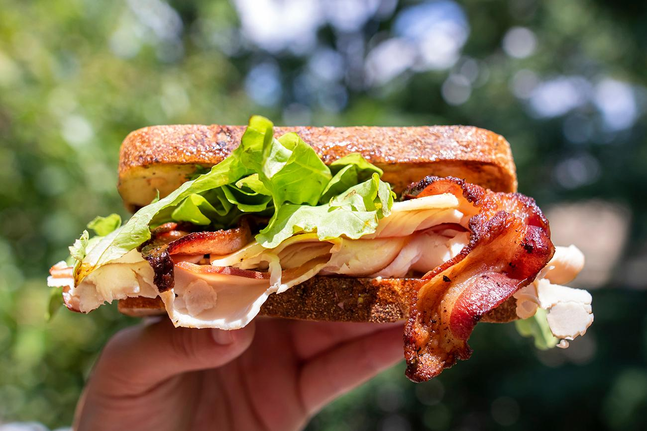 Gobbler: smoked turkey, bacon, white cheddar, and greens with lemon aioli / Image: Allison McAdams // Published: 8.12.19