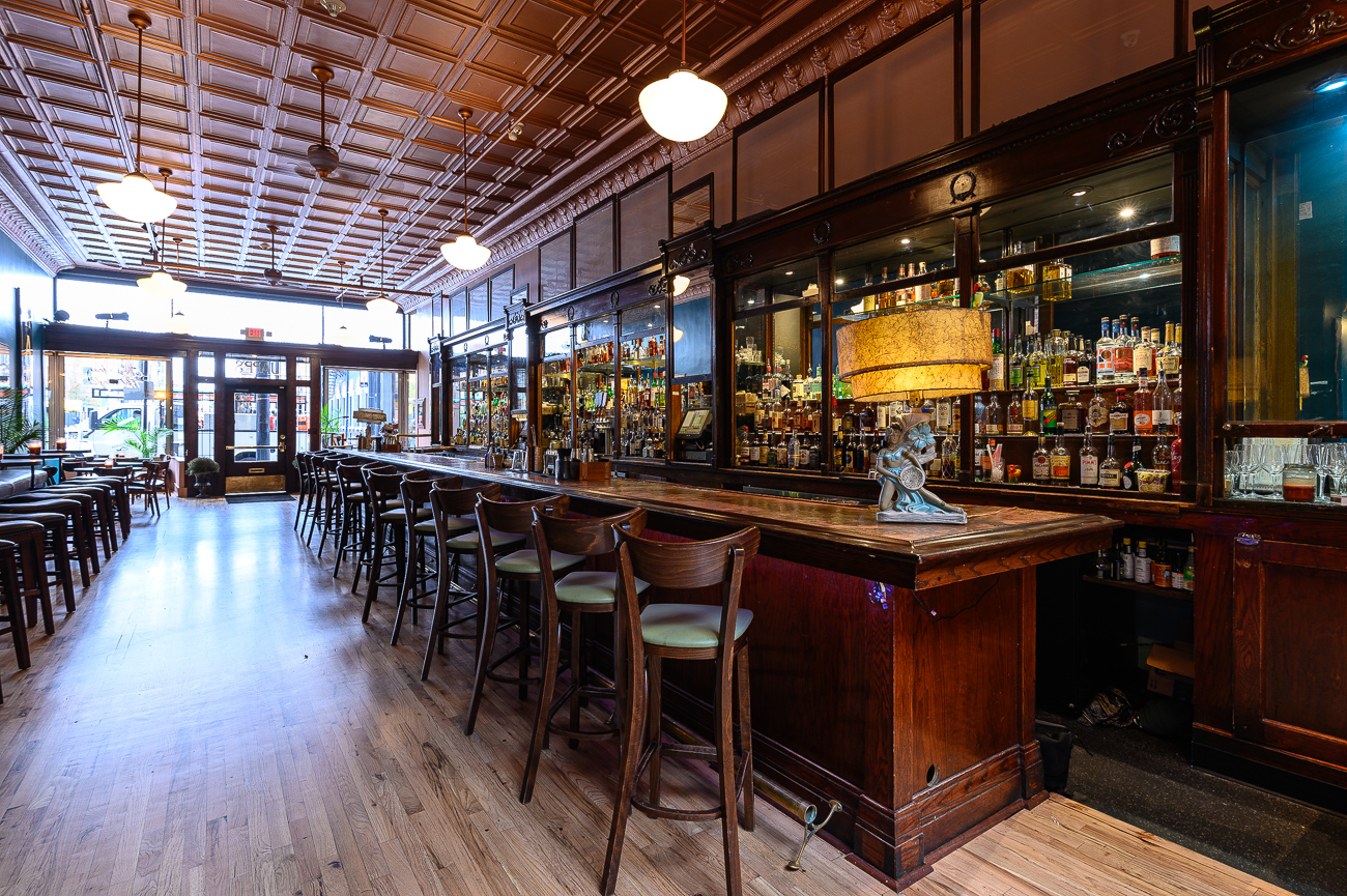 It took roughly three months to transform the old space. During that time, regulars patiently sat through closures and limited open hours, sometimes expressing concern about how their favorite Main Street bar would feel after it was refinished. Thankfully, with Molly at the helm driving the remodel, their fears dissipated when they saw the final build the weekend of BLINK. She made sure the changes made to Japp's enhanced the original features of the storied 1870s building while simultaneously paying homage to Cincinnati and its people. / Image: Phil Armstrong, Cincinnati Refined // Published: 10.25.19