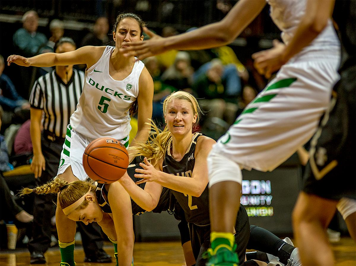 Idaho's Karlee Wilson (#2) looks for a teammate to pass to after picking up a loose ball. The UO Ducks Women's basketball team took the win against Idaho on Tuesday at Matthew Knight Arena, 73-70, in a game that saw the Ducks force a miss at the buzzer. Maite Cazorla (#5) achieved a double-double with 14 points and 10 assists. Lexi Bando (#10) added 17 points, and made 5 out of 6 three pointers. The Ducks are now 10-2 this season. Photos by August Frank, Oregon News Lab