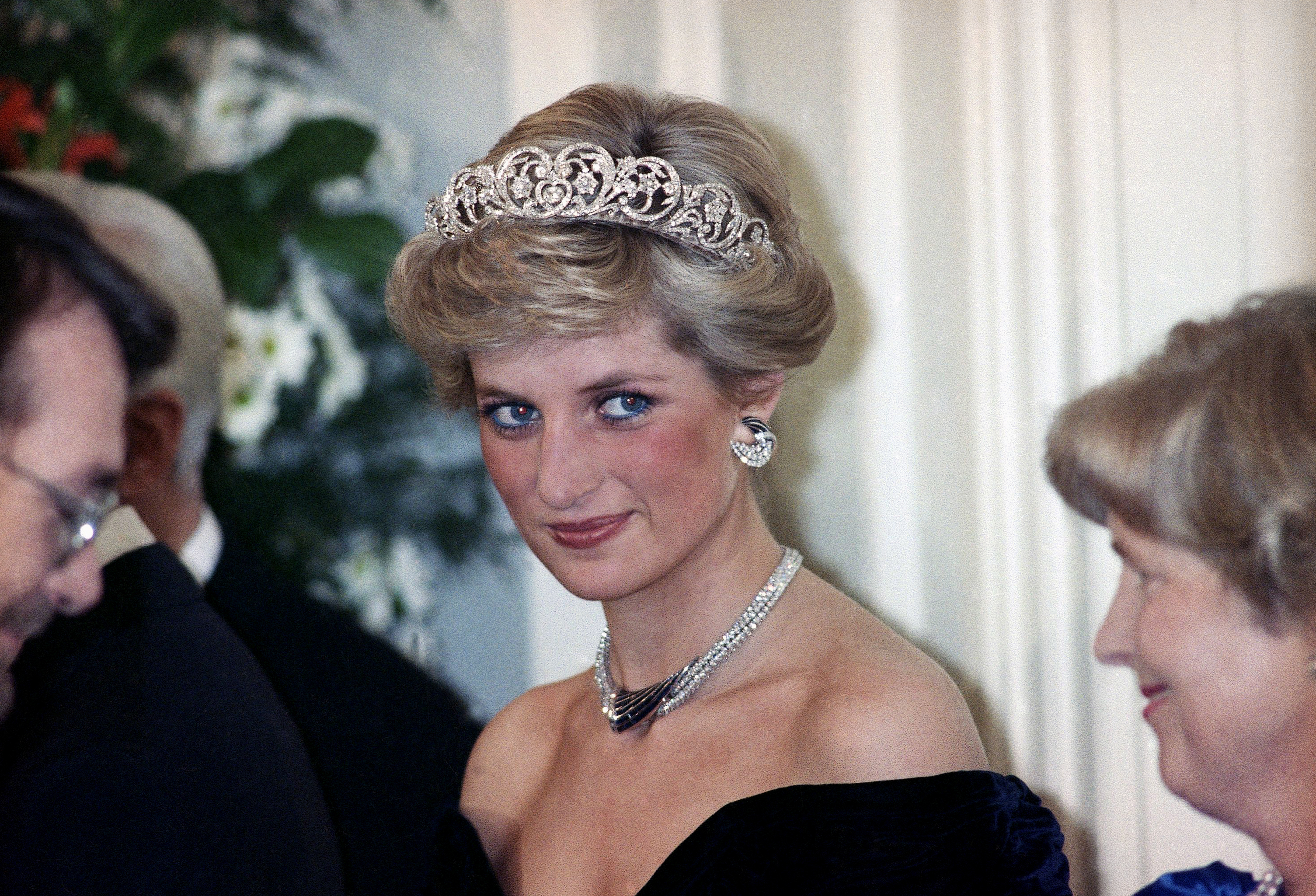 "FILE - In this Monday, Nov. 2, 1987 file photo, Britain's Diana, the Princess of Wales, is pictured during an evening reception given by the West German President Richard von Weizsacker in honour of the British Royal guests in the Godesberg Redoute in Bonn, Germany. It has been 20 years since the death of Princess Diana in a car crash in Paris and the outpouring of grief that followed the death of the ""people's princess."" (AP Photo/Herman Knippertz, File)"