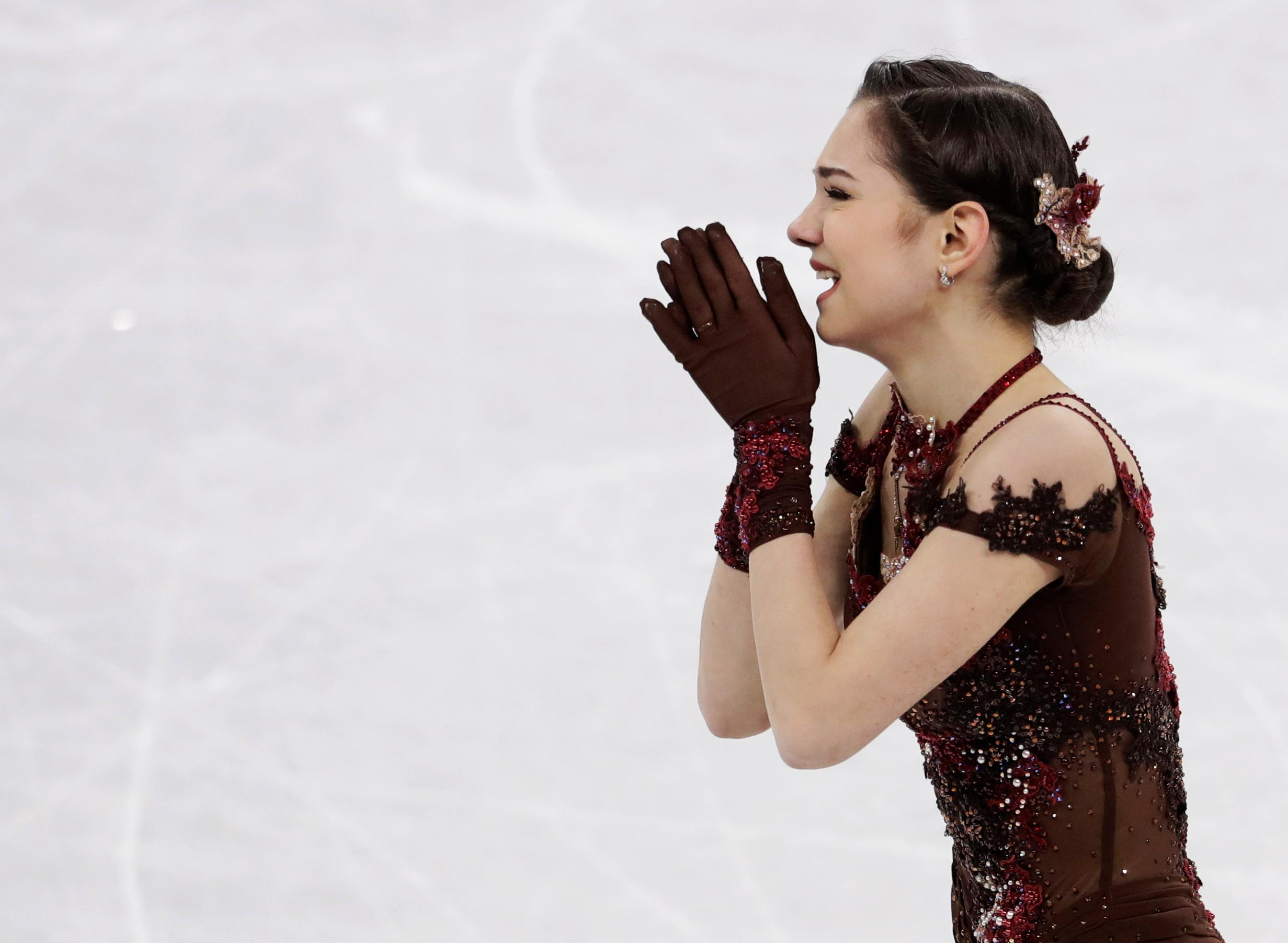 Evgenia Medvedeva of the Olympic Athletes of Russia reacts after her performance during the women's free figure skating final in the Gangneung Ice Arena at the 2018 Winter Olympics in Gangneung, South Korea, Friday, Feb. 23, 2018. (AP Photo/Petr David Josek)