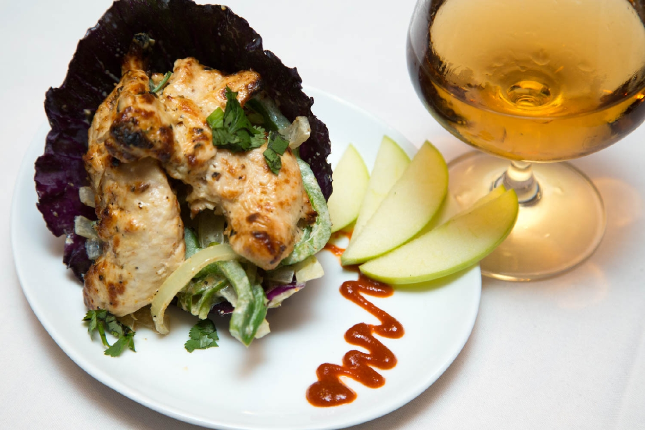 Chicken of Afgani served with carmelized onion and peppers  - served with a glass of neat scotch / Image: Catherine Viox
