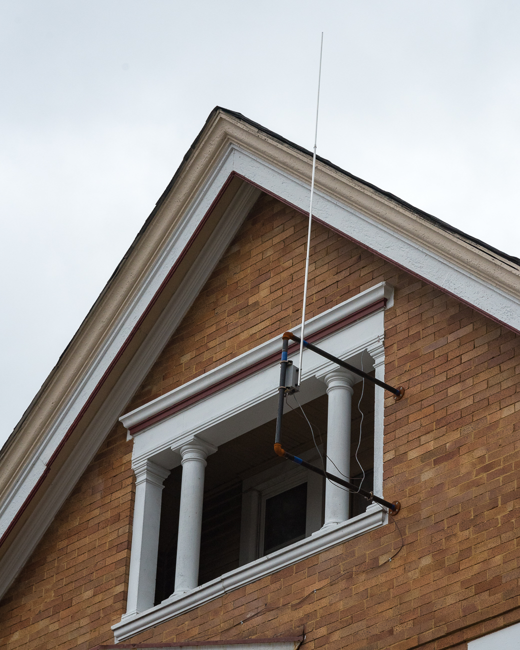 The antenna for the whole station is affixed to the exterior of the former rectory building where Radio Artifact broadcasts. / Image: Phil Armstrong, Cincinnati Refined // Published: 1.15.18<p></p>