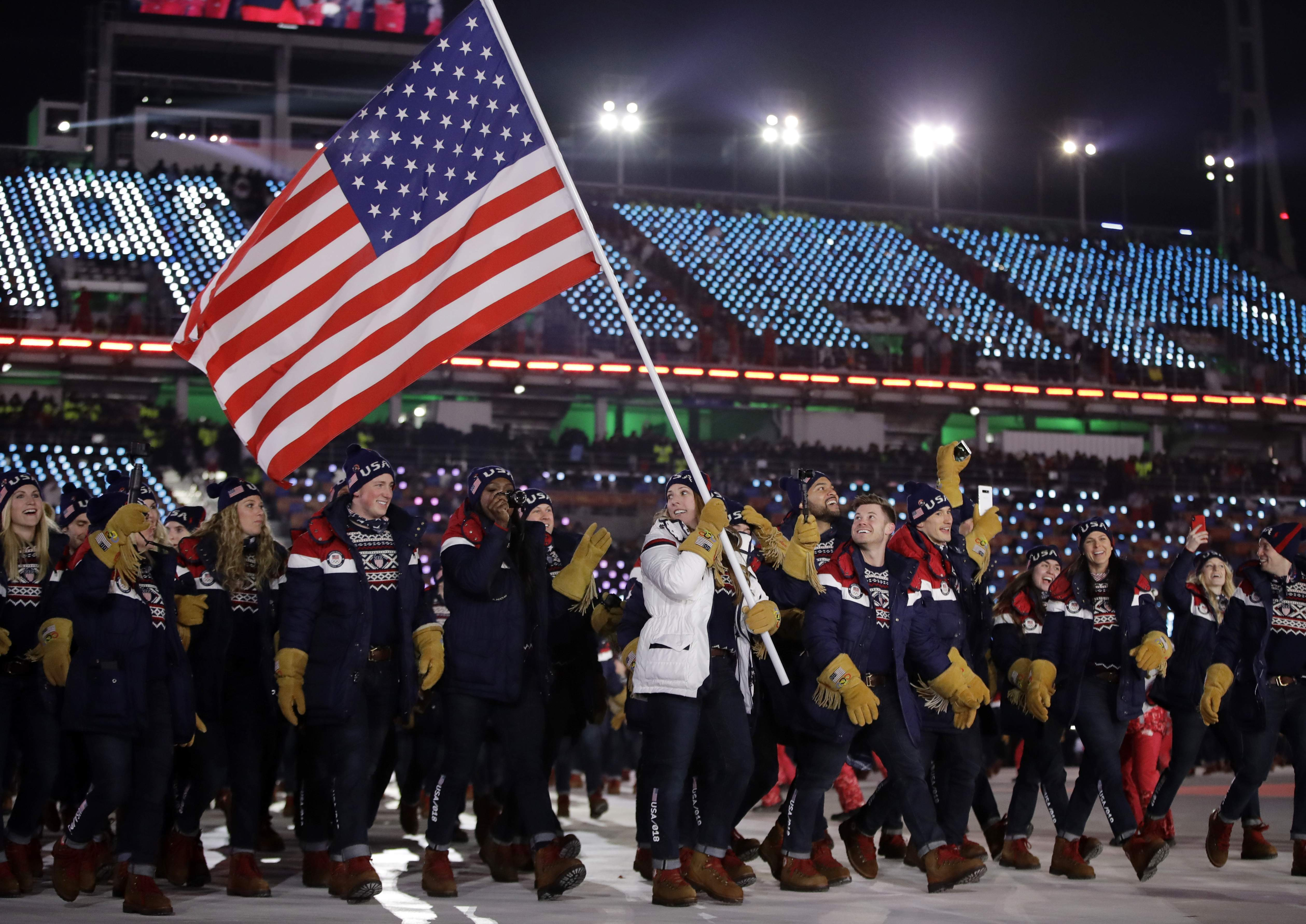 Erin Hamlin carries the flag of the United States during the opening ceremony of the 2018 Winter Olympics in Pyeongchang, South Korea, Friday, Feb. 9, 2018. (AP Photo/Vadim Ghirda)