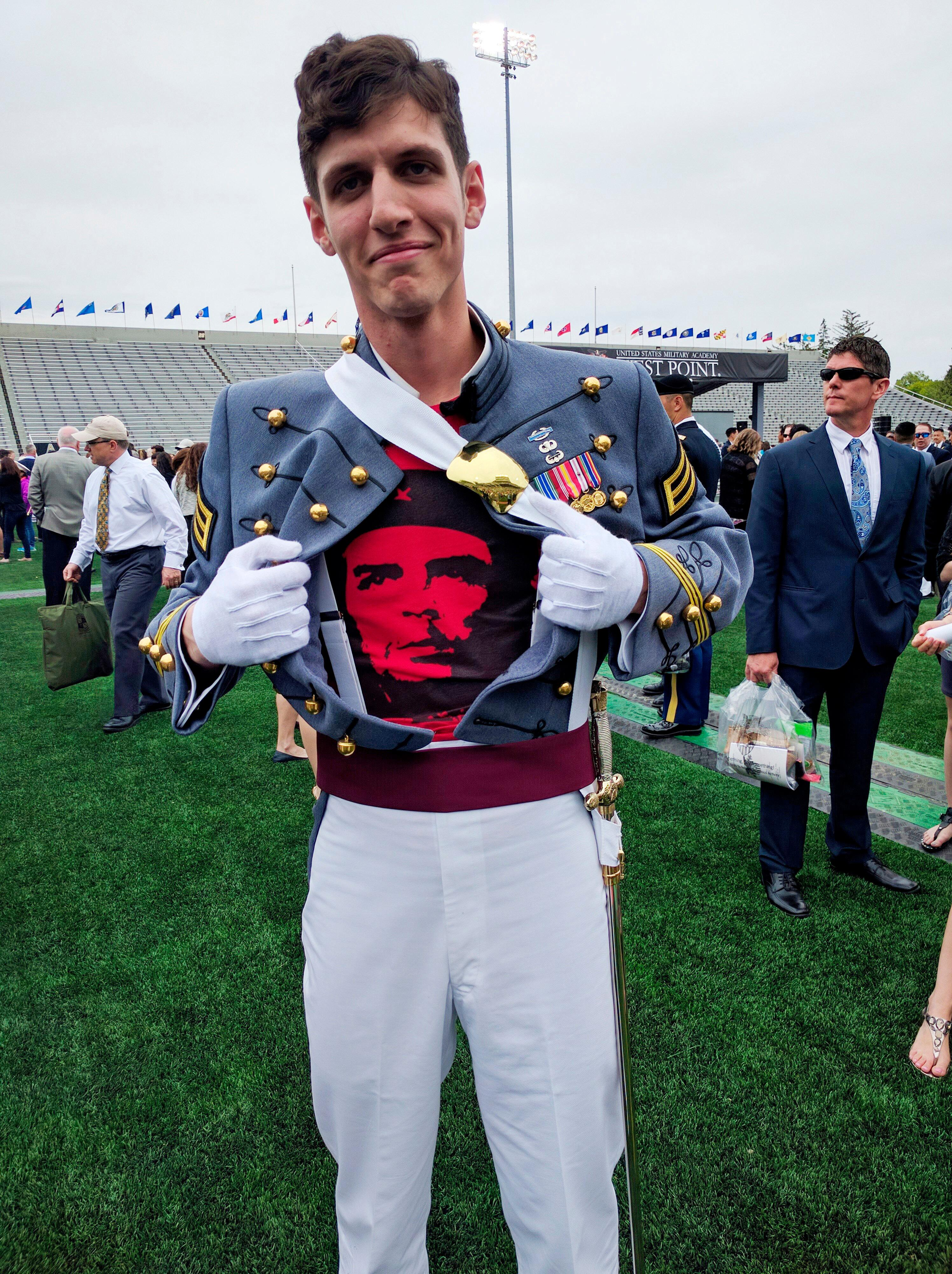 In this May 2016 photo provided by Spenser Rapone, Rapone displays a shirt bearing the image of socialist icon Che Guevara under his uniform, after graduating from the United States Military Academy. (Courtesy of Spenser Rapone via AP)